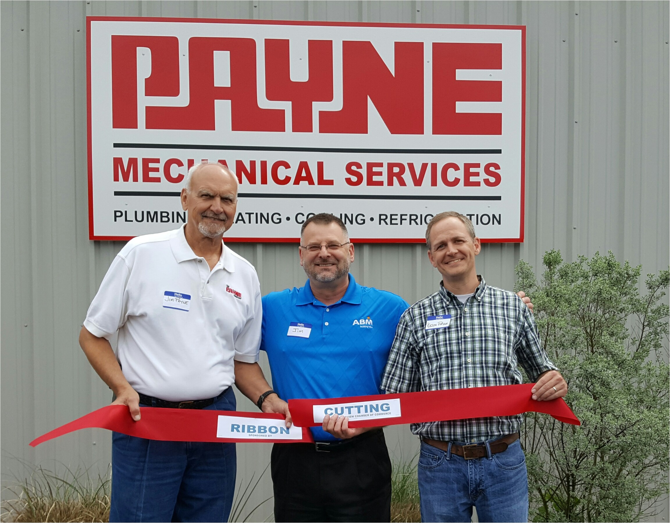 payne mechanical services principals jim payne left and keith payne right celebrate the opening of the company s new location in longview texas