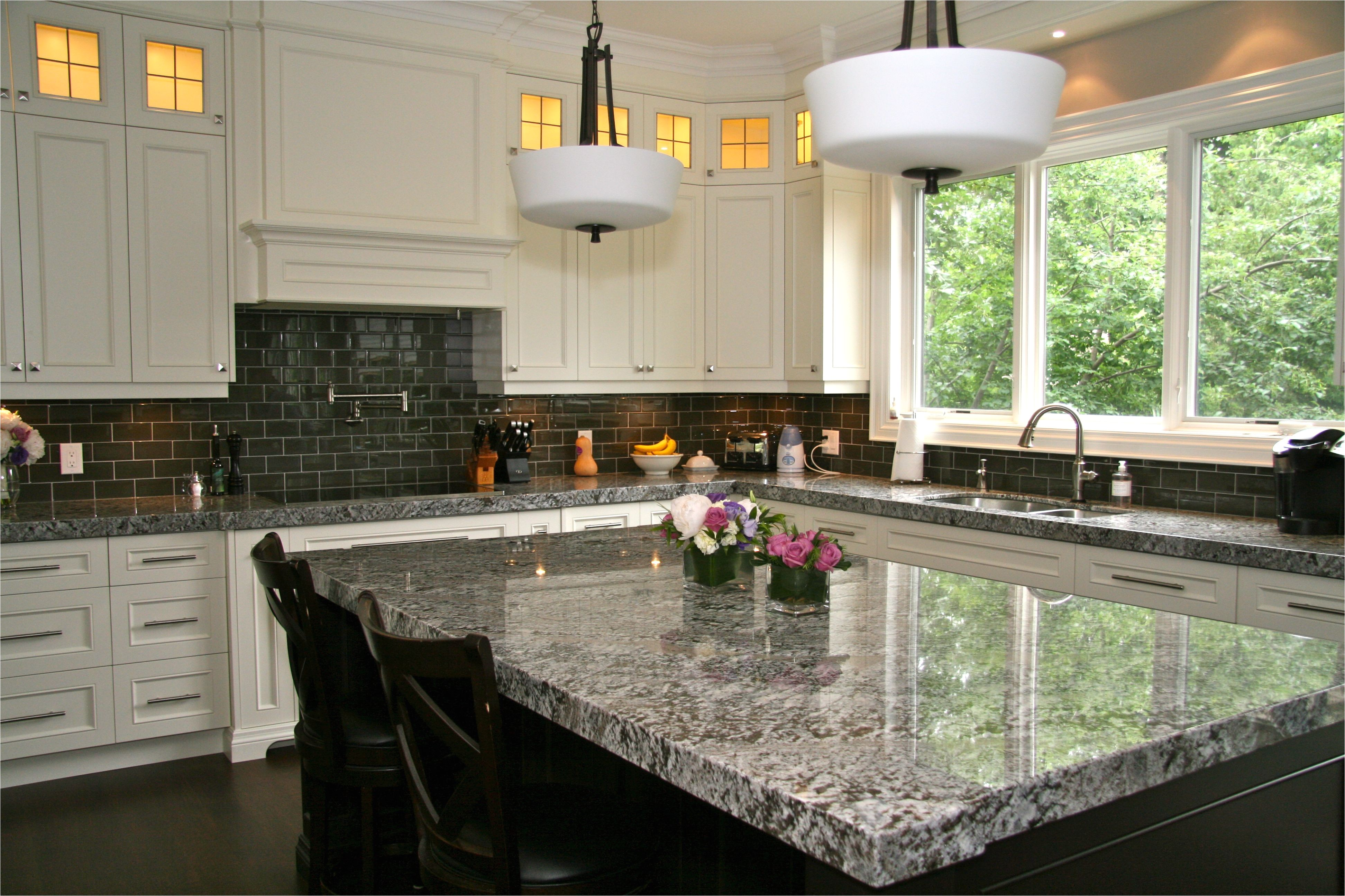 lennon granite completed with gray subway tiles and cupboard back lighting www marbleandmarble com lennon granite kitchen subway tiles