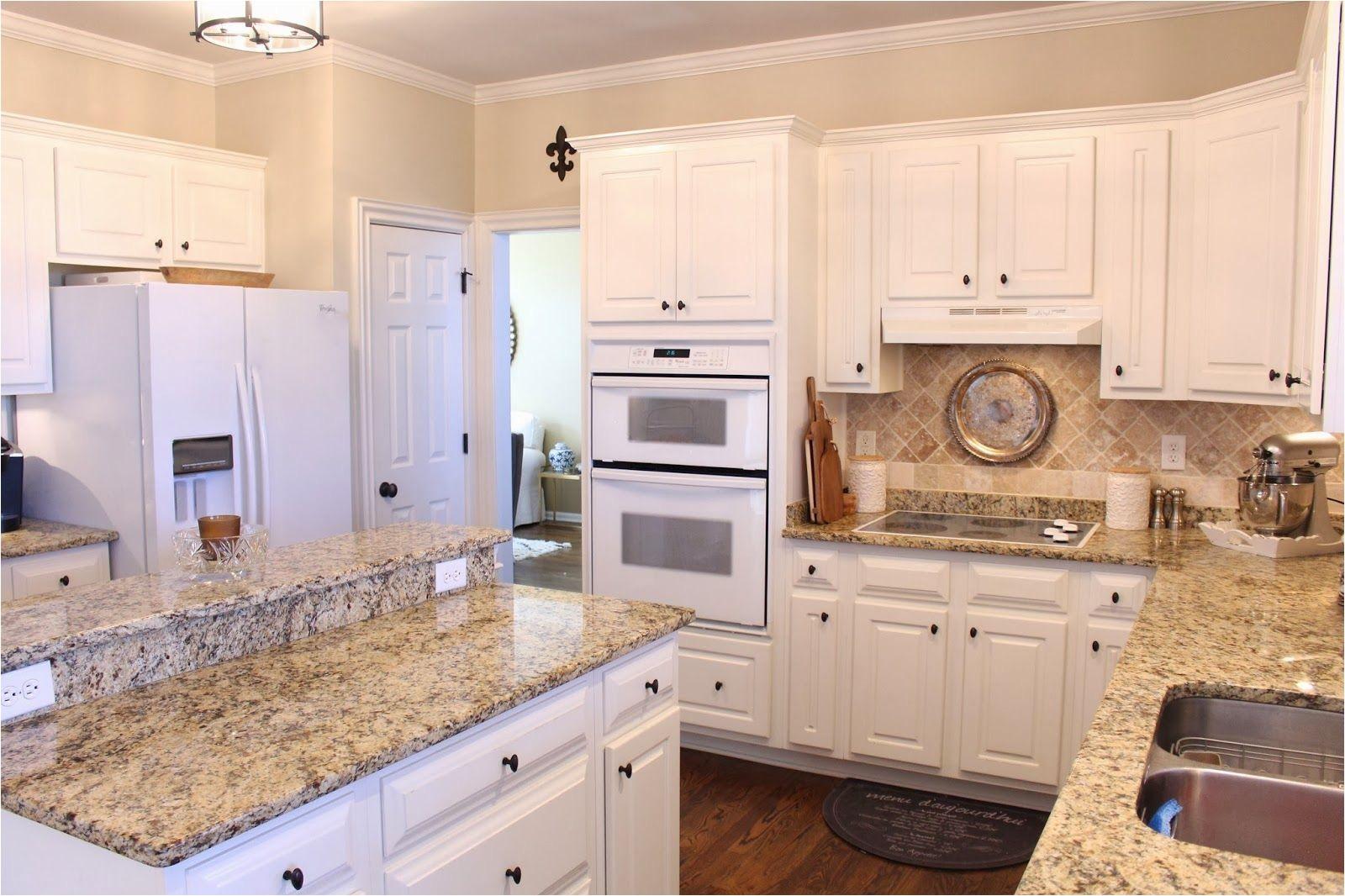 tiffanyd some progress in the kitchen beige kitchen cabinets white cabinets