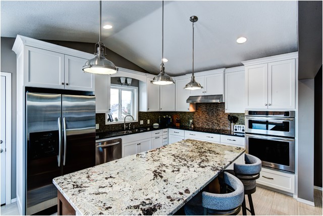 painted cabinets with alaska white granite on the island transitional kitchen minneapolis