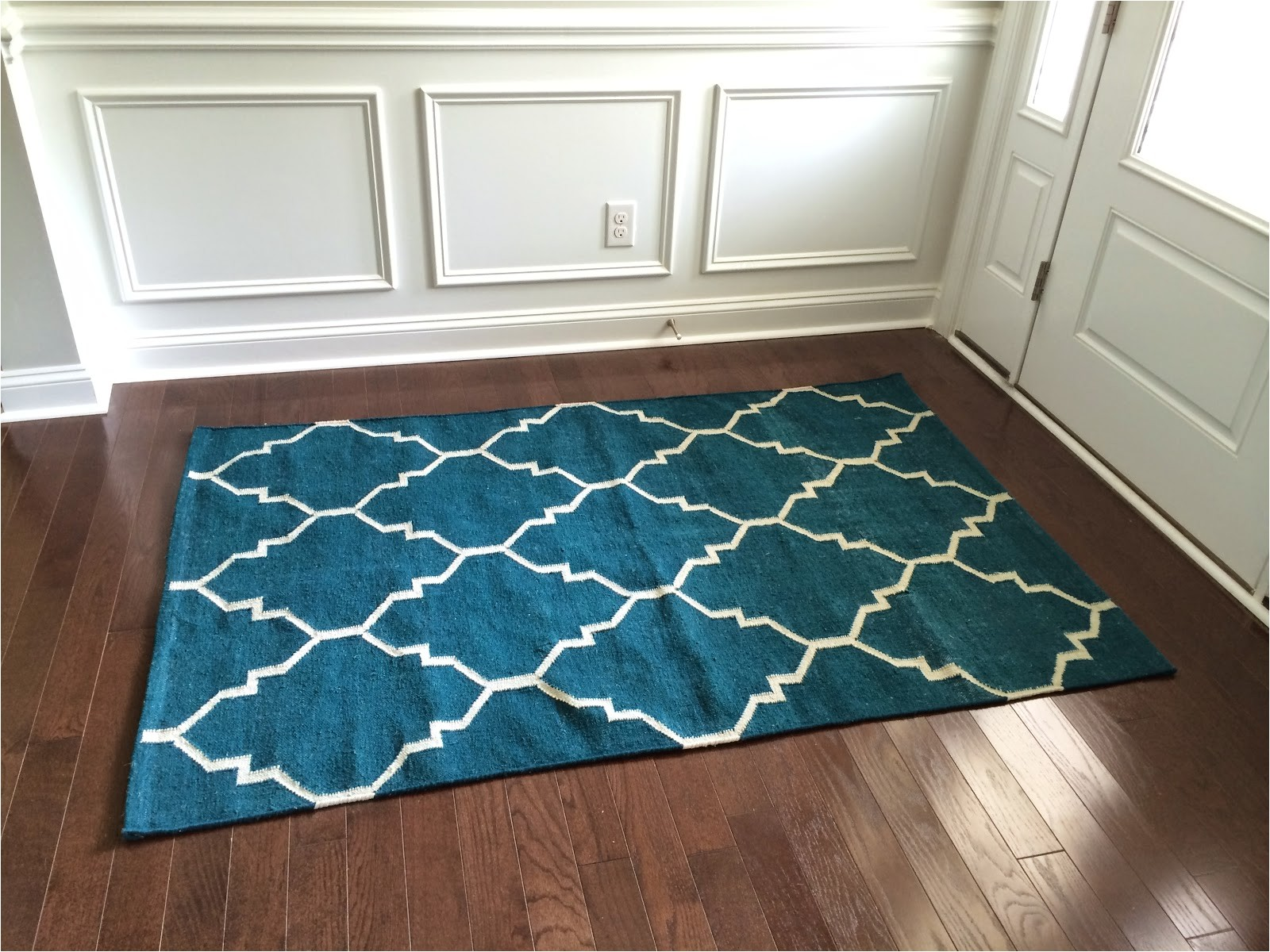 terrific home goods rug artisan de luxe home rug wooden floor white wall rug white and blue motif