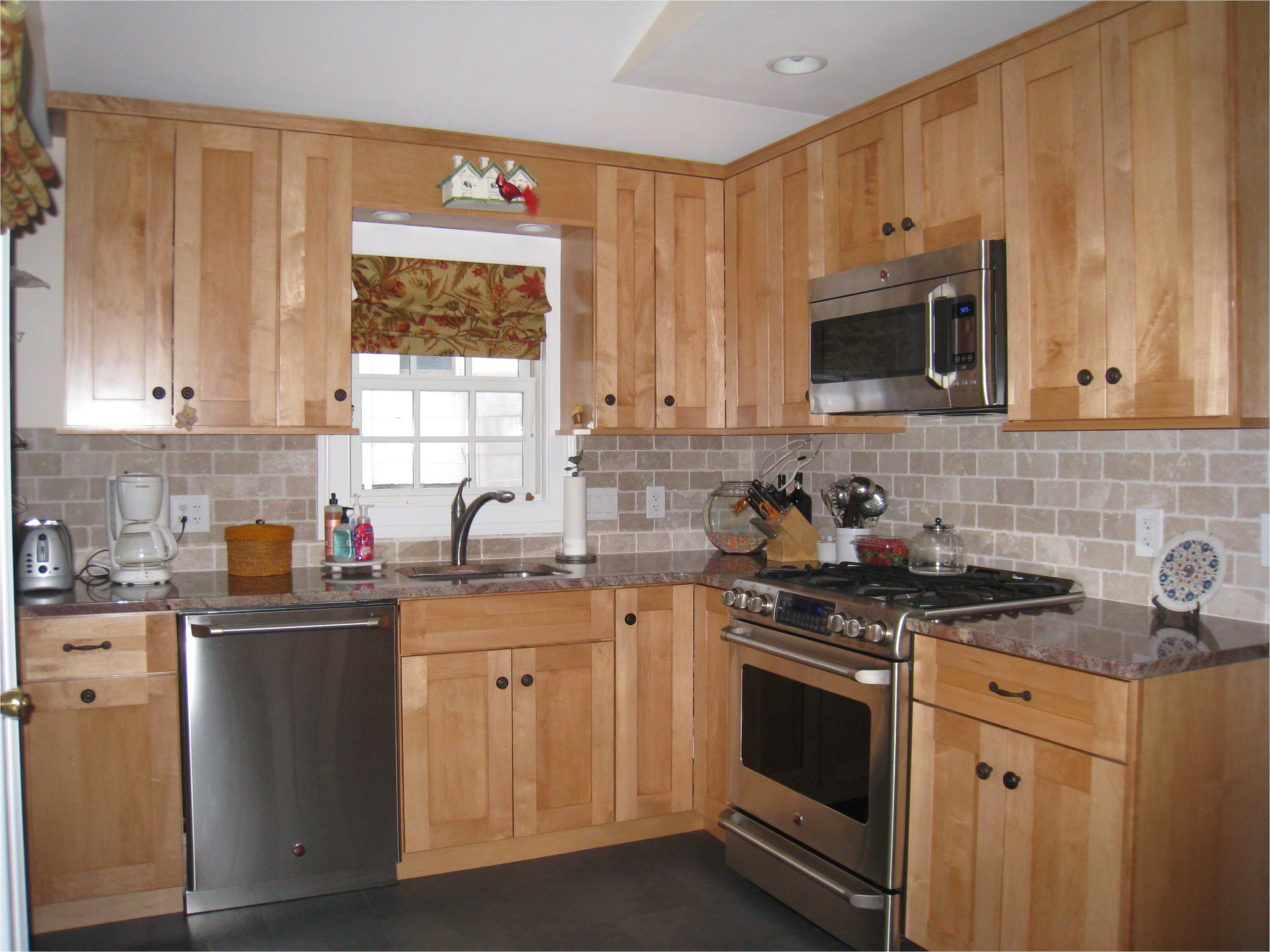 Backsplash Ideas for Black Granite Countertops and Maple ... on Maple Cabinets With Black Granite Countertops  id=57583