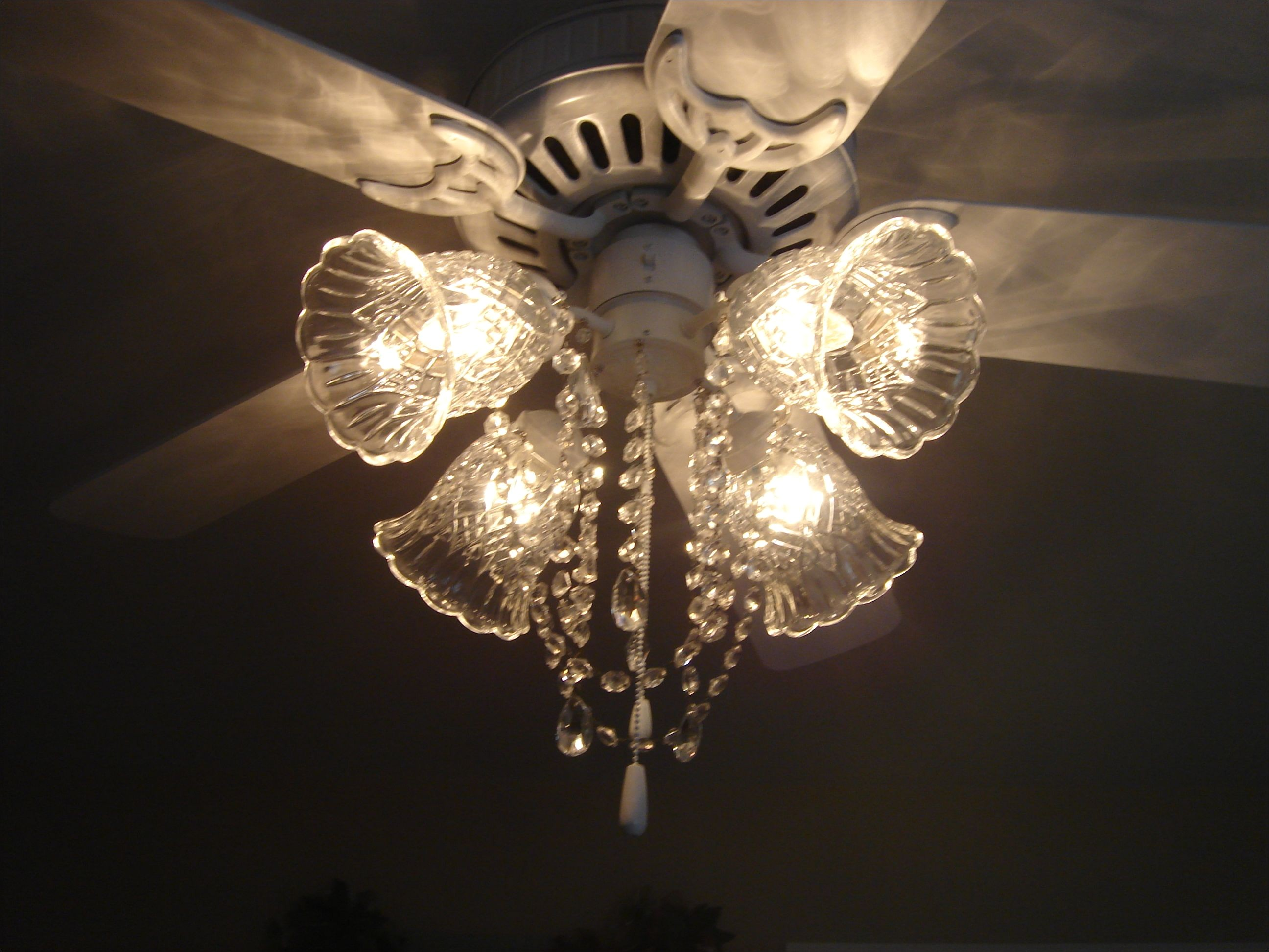 ceiling fan after picture painted white and made into a fan chandelier added