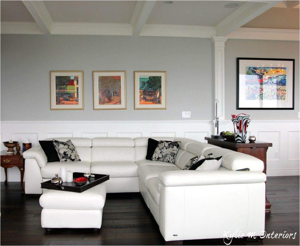 best benjamin moore gray paint color stonington gray shown with white leather sectional dark wood floors and wainscoting