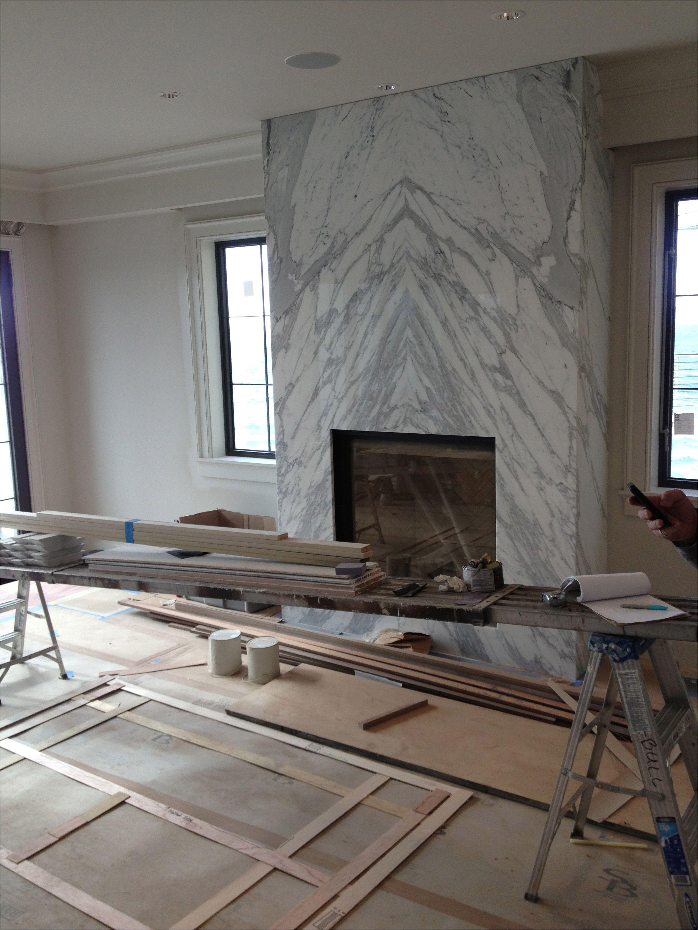 contemporary slab stone fireplace calacutta carrara marble book matched stone slab gas fireplace insert raised box interior design by dixiestark com