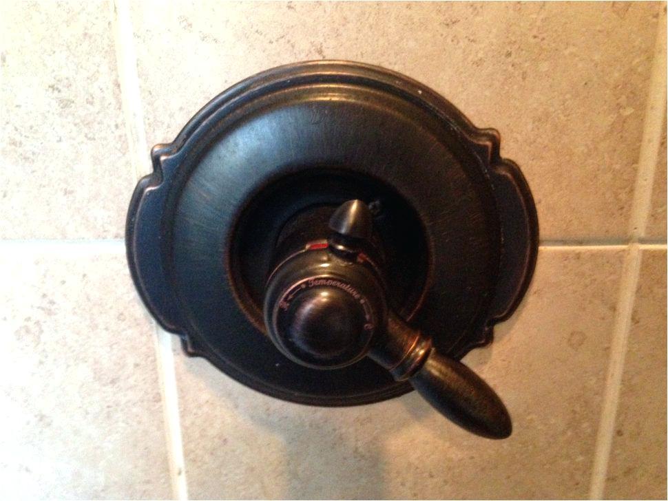 delta monitor shower faucet temperature adjustment