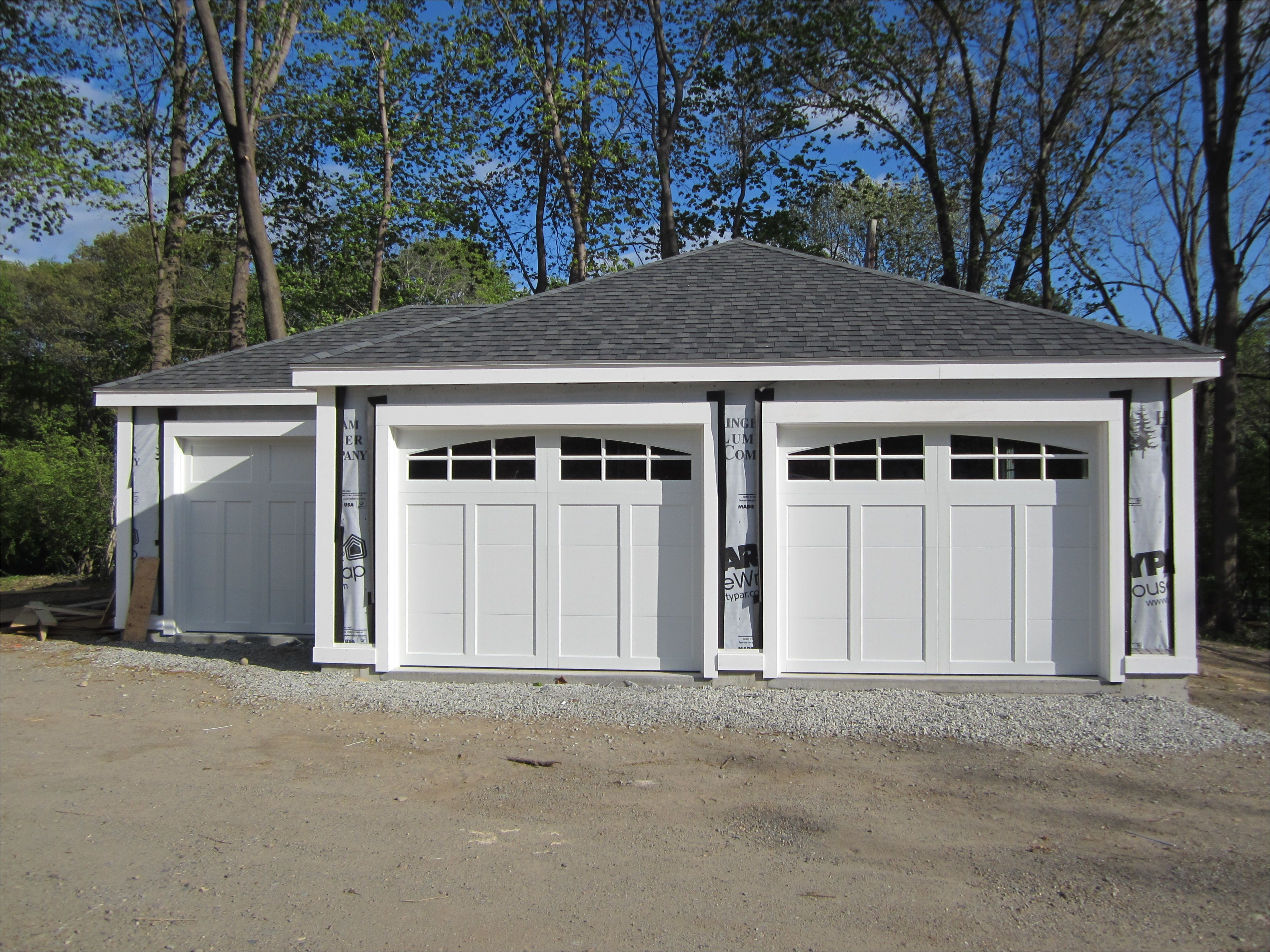 haas american tradition model 921 steel carriage house style garage doors in white with arch 6 pane glass installed by mortland overhead door