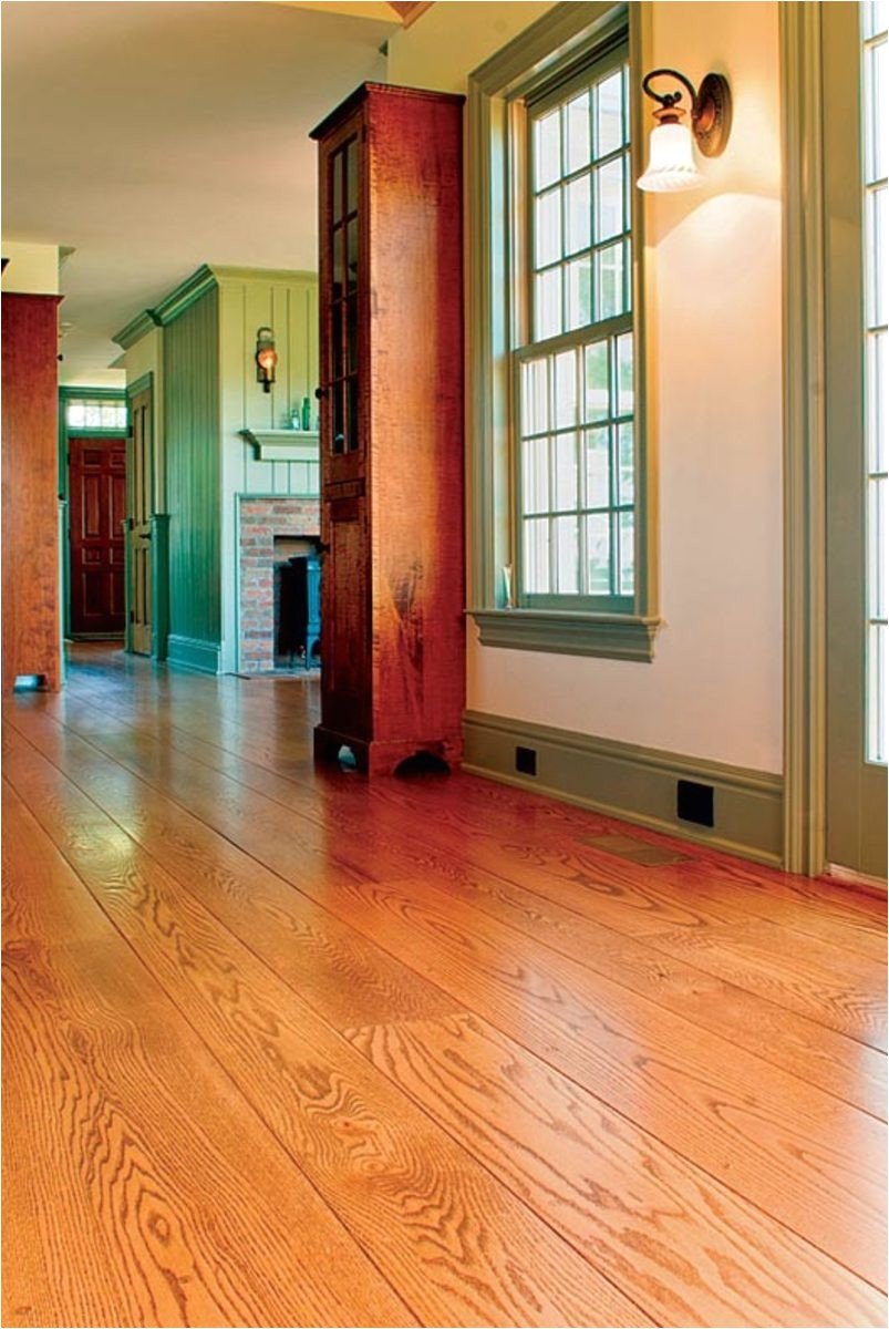 using wide plank flooring can help a new addition blend with an old house
