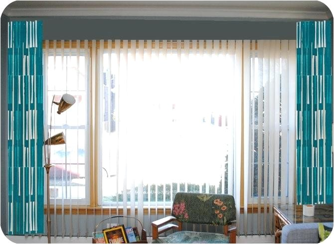 how to hang curtains over vertical blinds without drilling