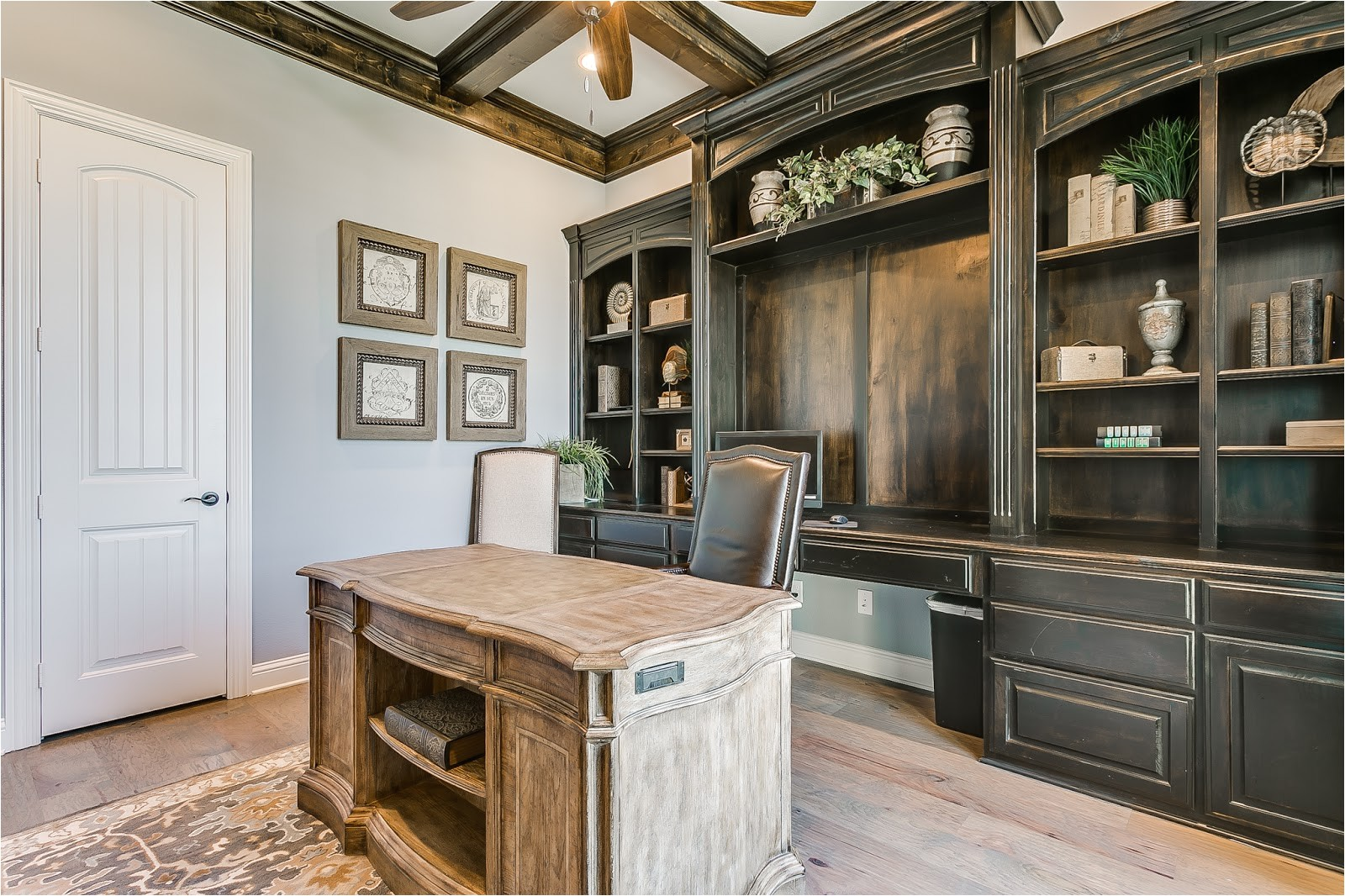 once you pass through the wood trimmed arch way a living and kitchen area decorated with a serene yet modern feel is discovered