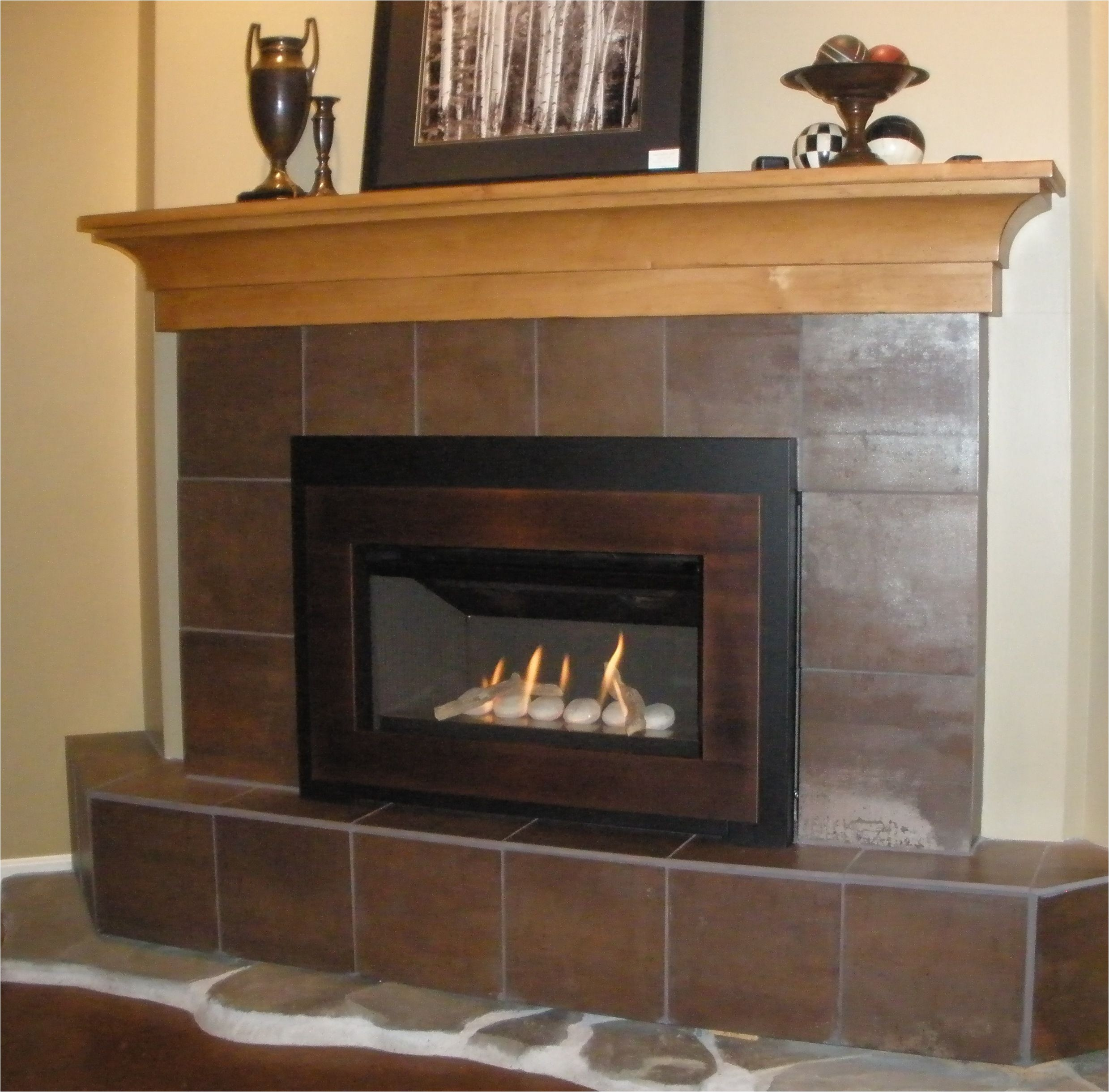 valor g3 739irn gas fireplace insert with creekside rock bed fire effect and brushed copper surround