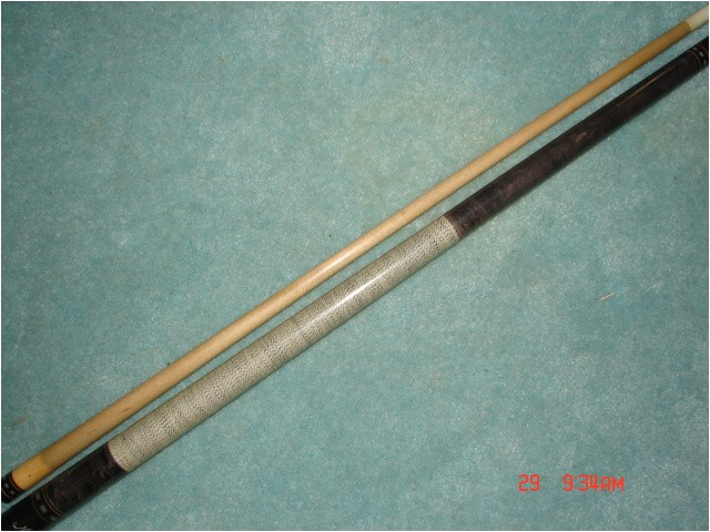 meucci cue with red dot shaft for sale 180