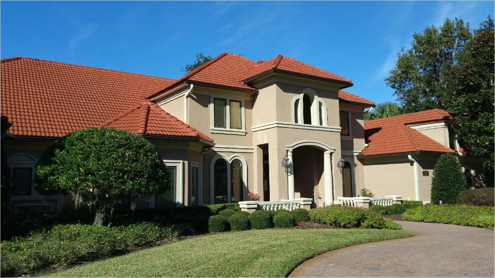 7 inch seamless gutters installed on this elegant stucco home