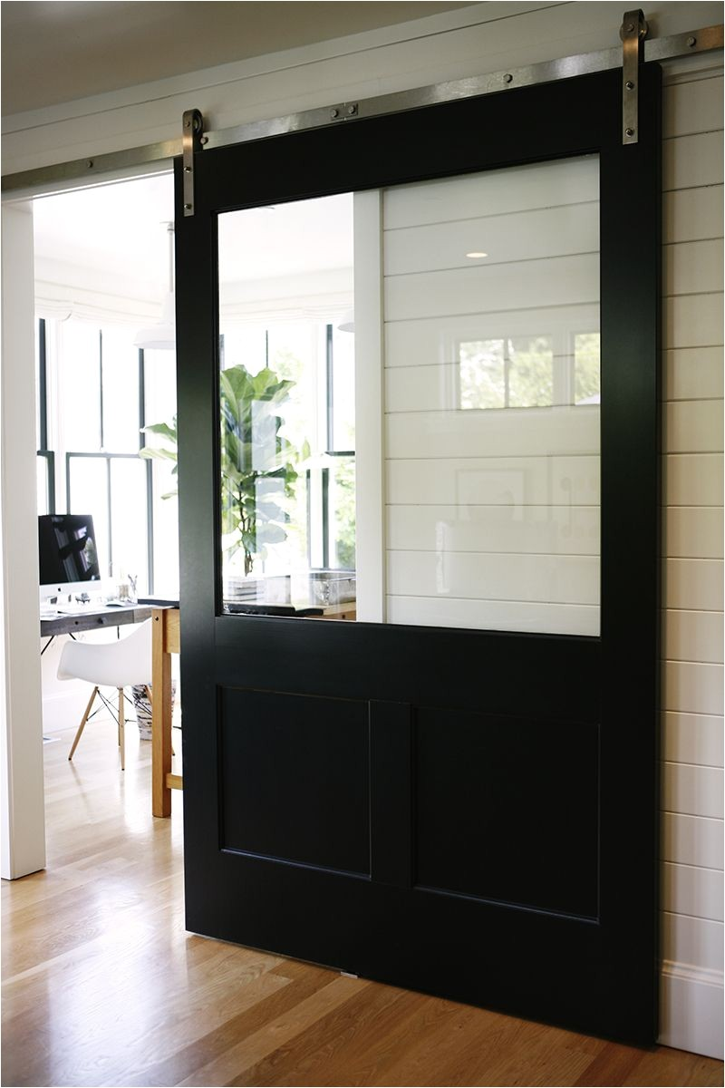 fresh take on the classic barn door this one is over sized with a glass top that keeps sight lines and lets in light