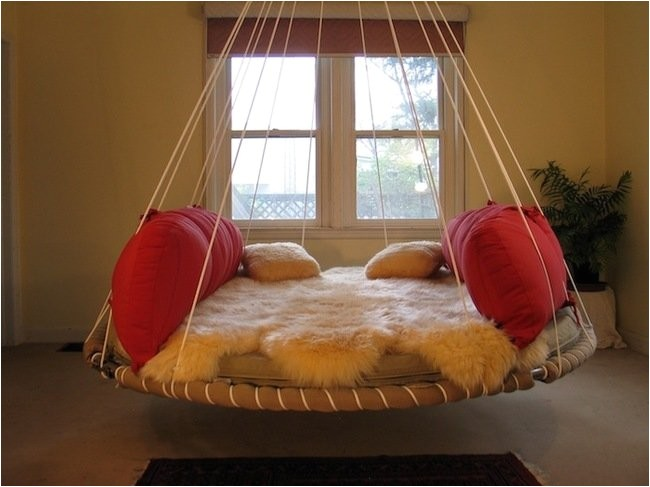 how to repurpose your old trampoline into a swing bed