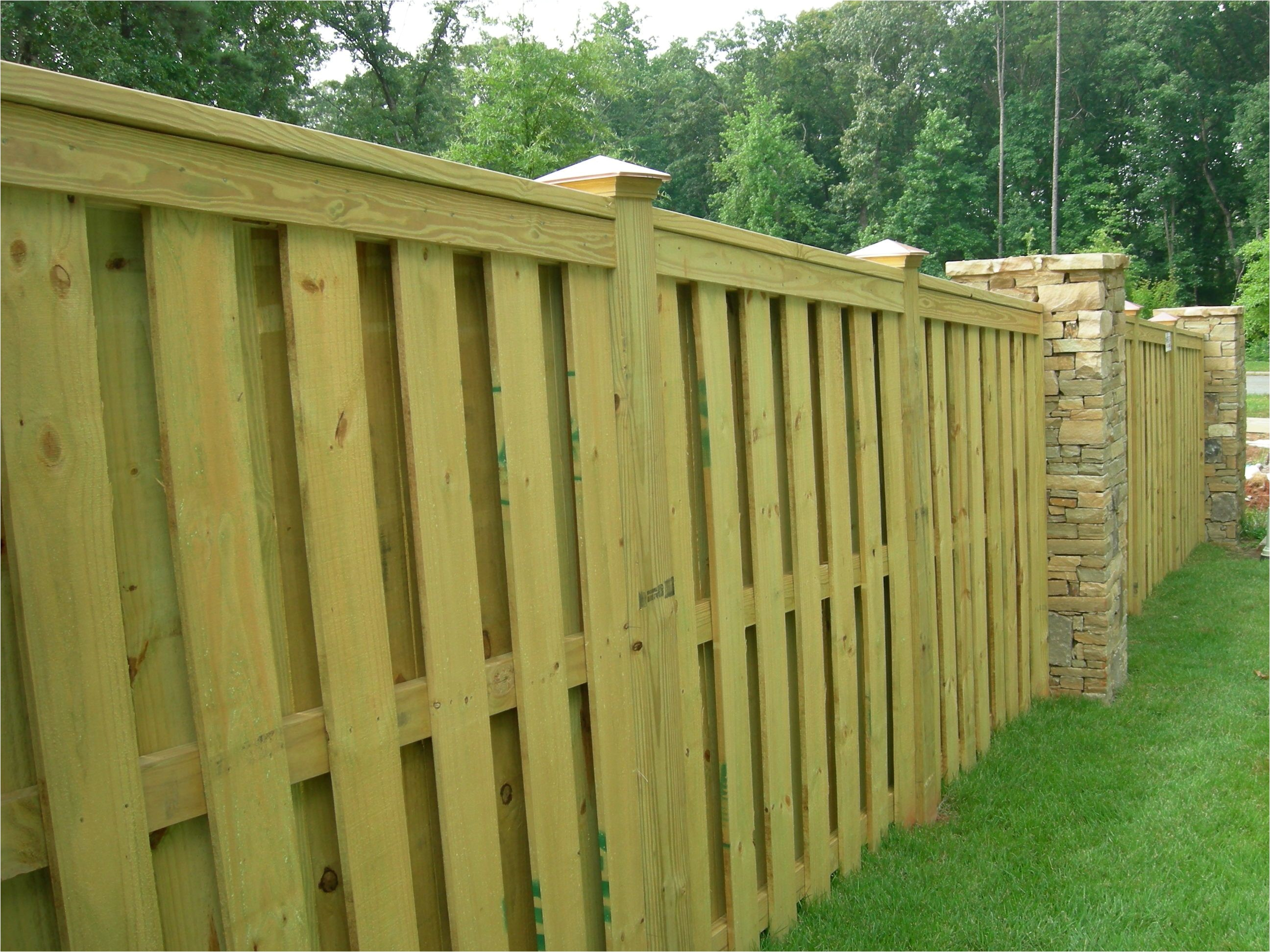 shadow box fence with trimmed top i am completely in love with this fence would like to have this without the brick to reduce costs