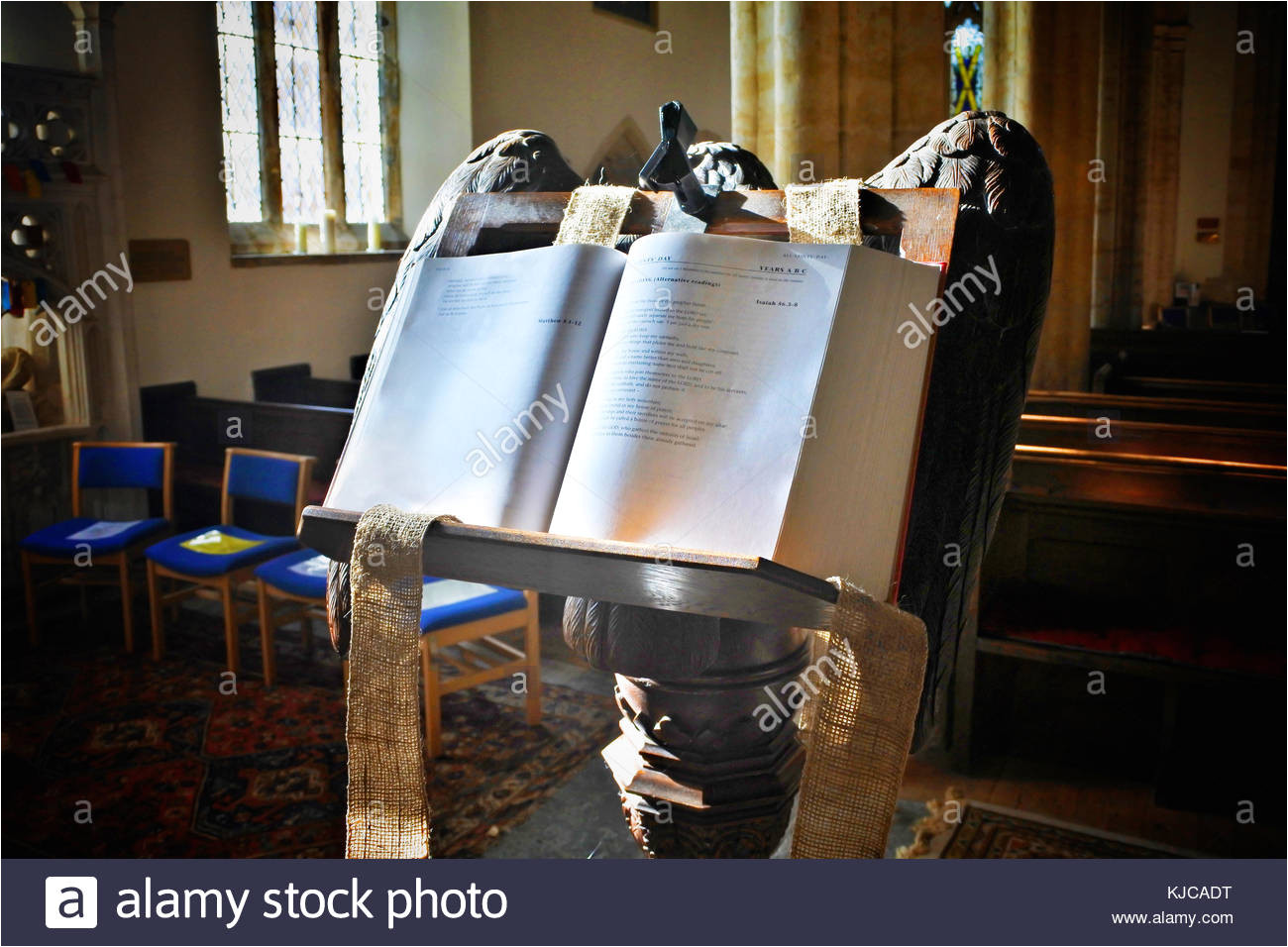 a holy bible open resting on the lectern at netherbury parish church dorset