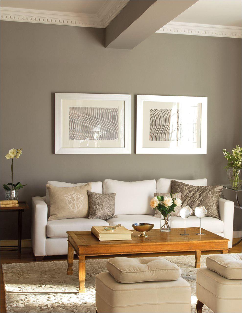 sala n con moldura en el techo pared gris y dos cuadros sobre el sofa dos obras en serie