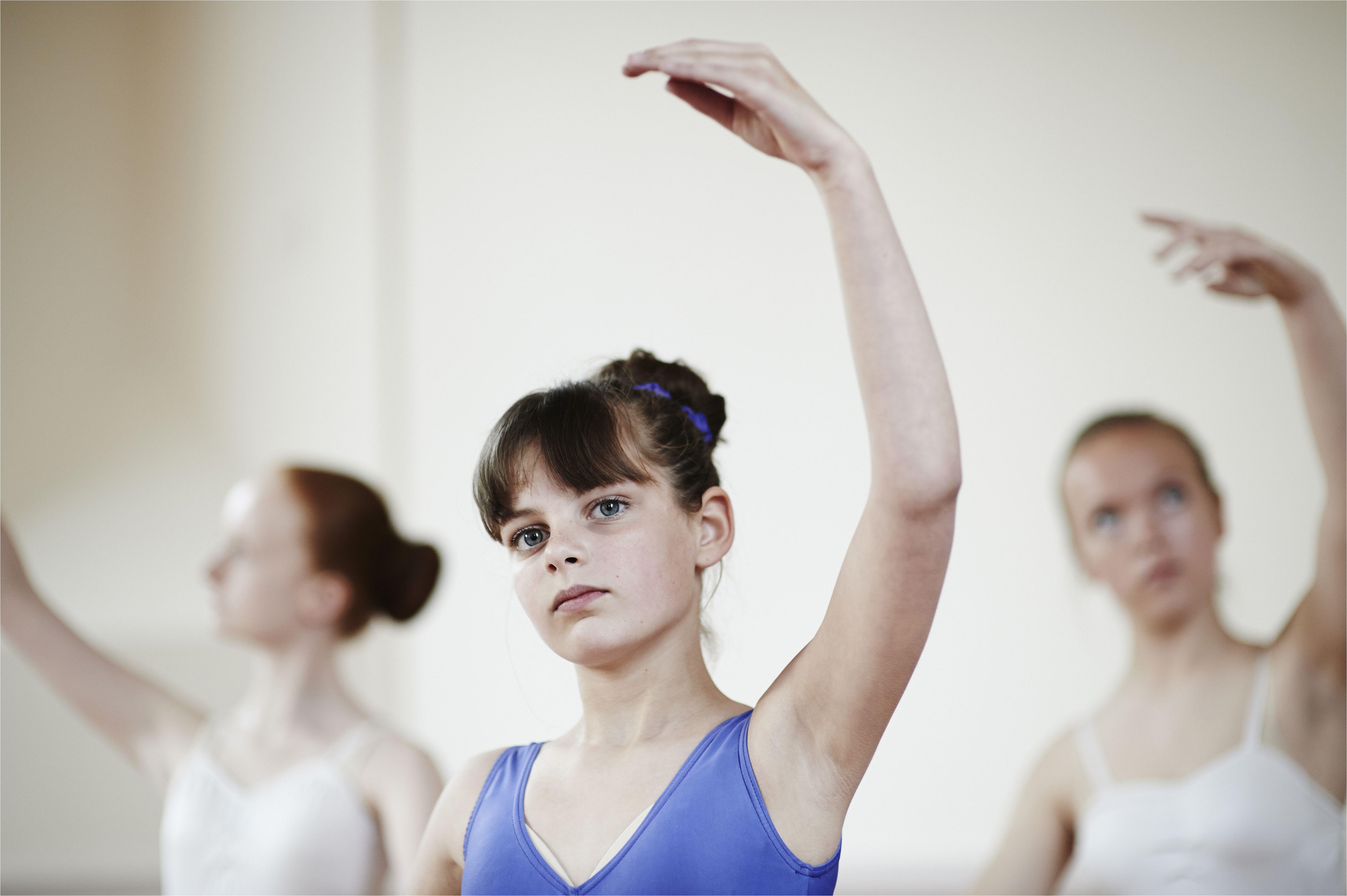 ballet dancers practising ballet pose 502369021 59f0cc7e0d327a00109b2746 jpg