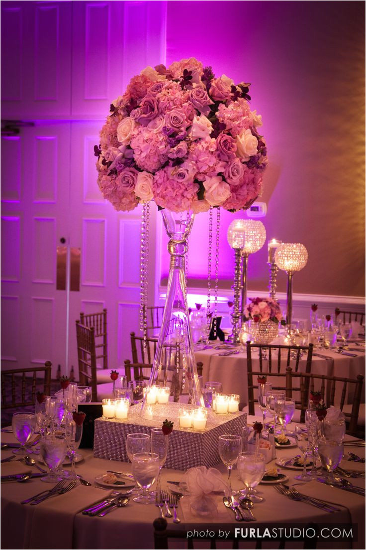 one of our most popular table designs large high centerpiece atop of a tulip vase