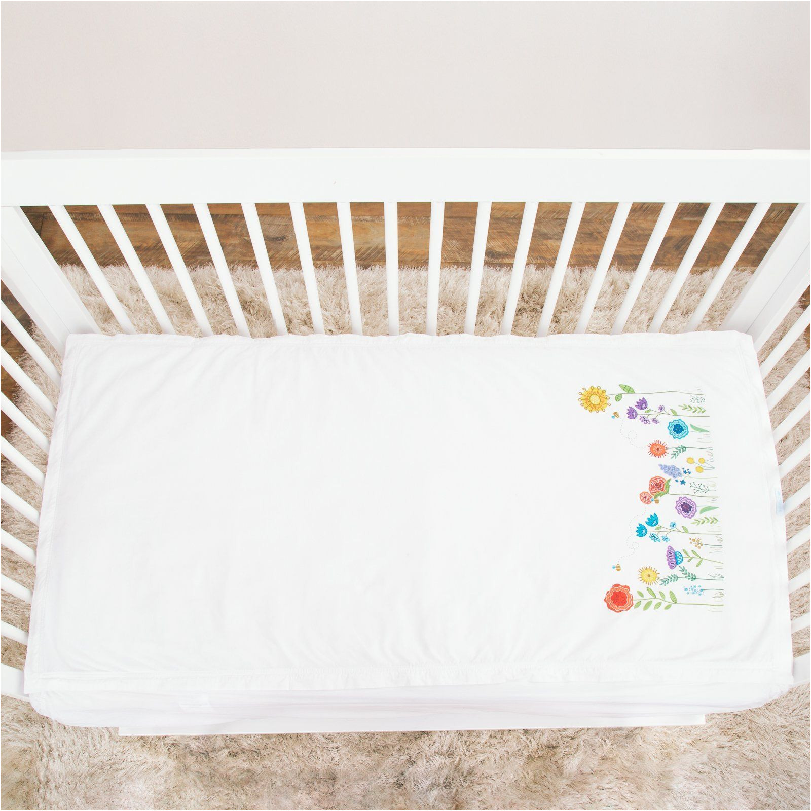 basic crib starter pack in white includes 1 wraparound base in white 1 cotton zip on sheet with sprouting garden print
