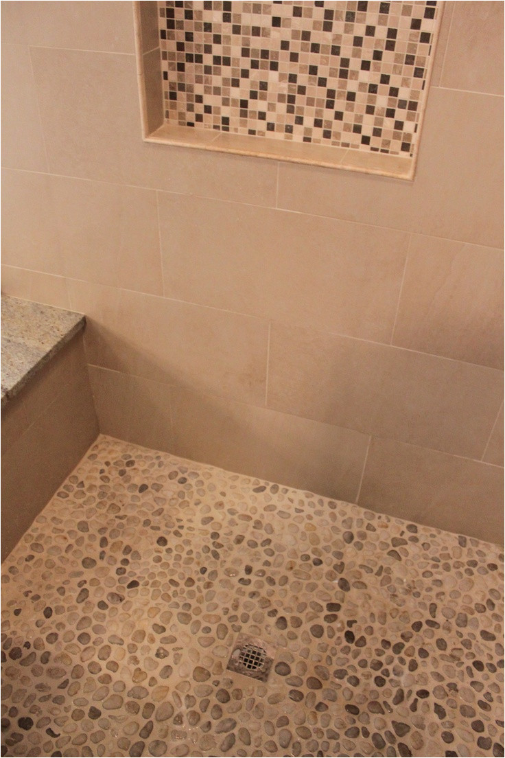 riverwashed pebbles as the shower floor i like the idea wonder how