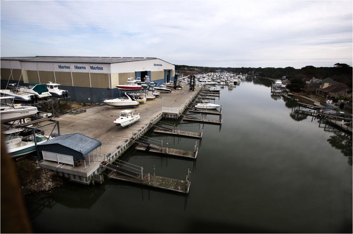 waterfront luxury apartments and restaurant would replace part of virginia beach marina built in 1980s