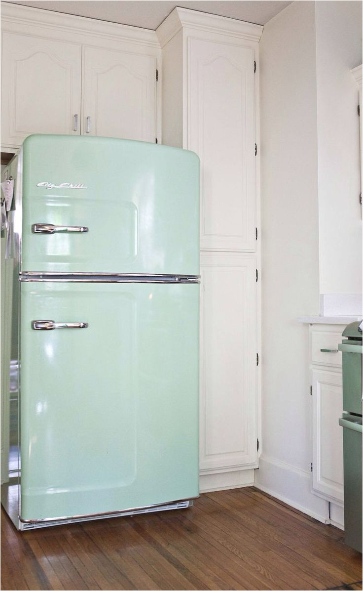 ballisty thelen this fridge is called big chill fridge and this kitchen is adorable love the unfinished wood shelves for glass and serving ware