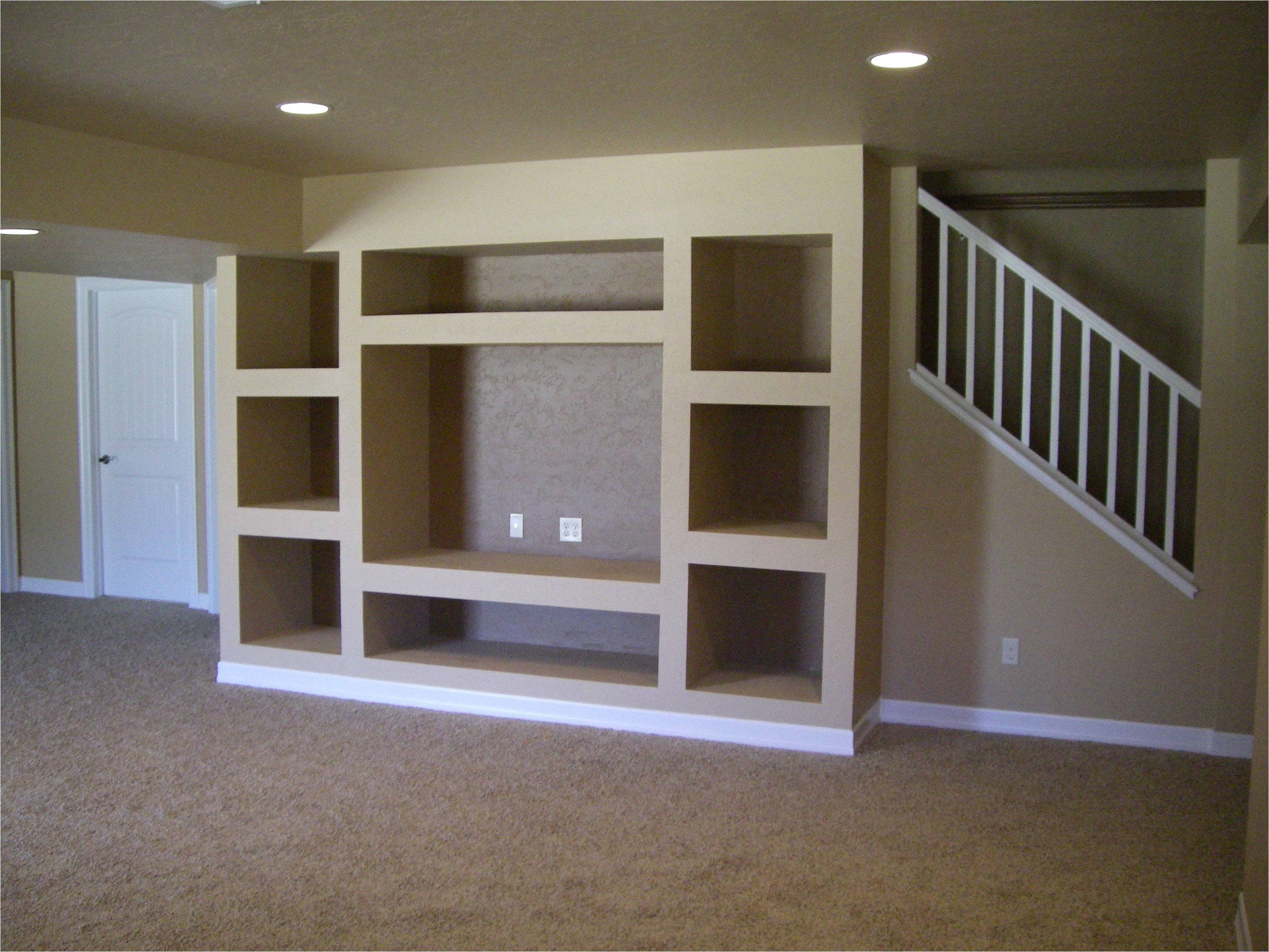 open stairs with support beam built in entertainment center only issue i see is that you would really have to like that spot for your tv and such to go