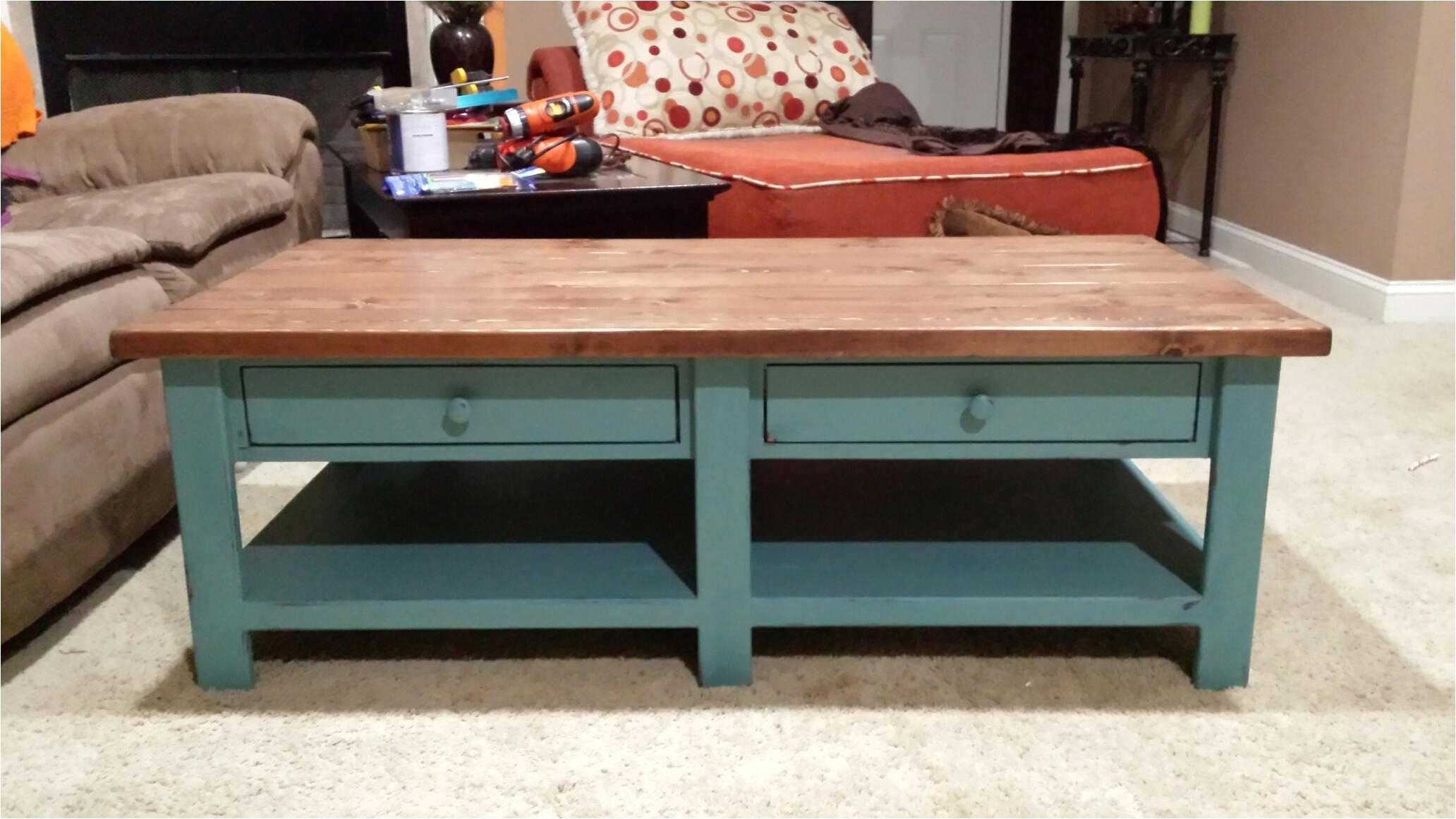 a coffee table with two drawers and a lower bench