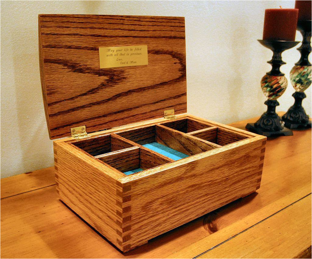 an open jewelry box on a dresser