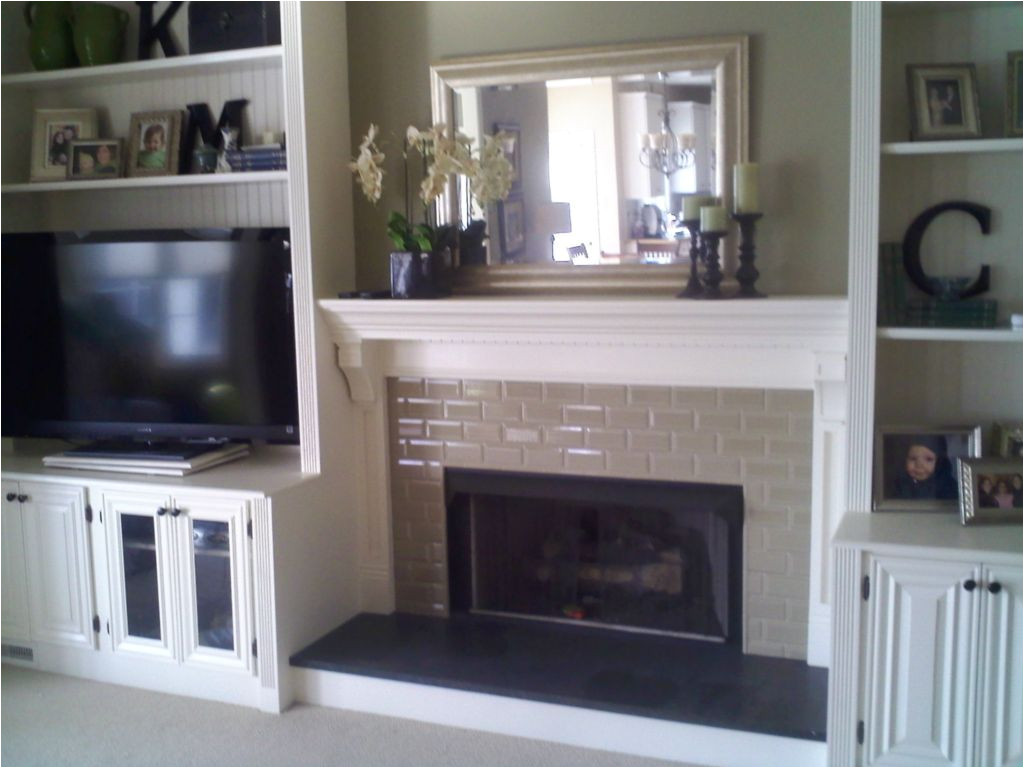fireplace with built in bookshelves custom trimwork and painting fireplace mantels built in cabinets
