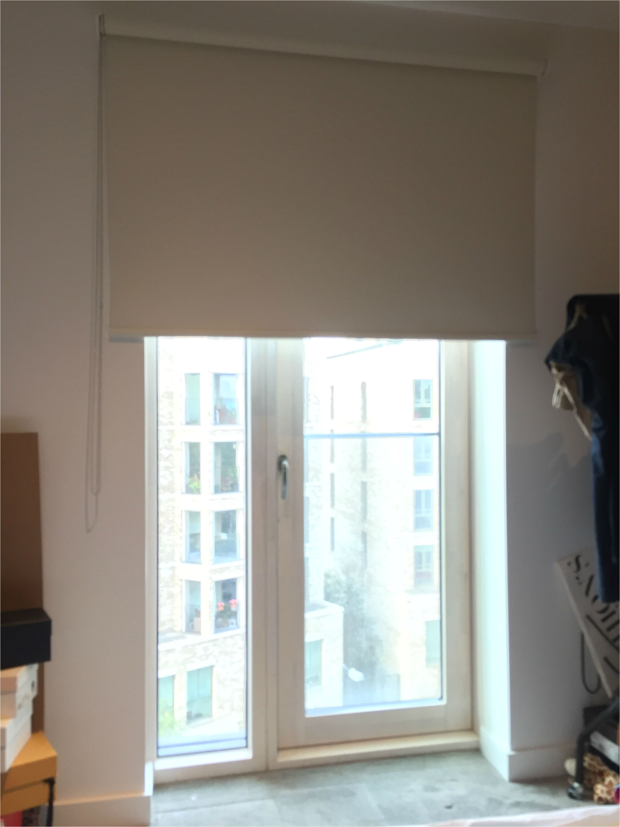 blackout roller blind fitted to french door to apartment in elephant castle london made to measure modern blinds blinds for doors outside recess
