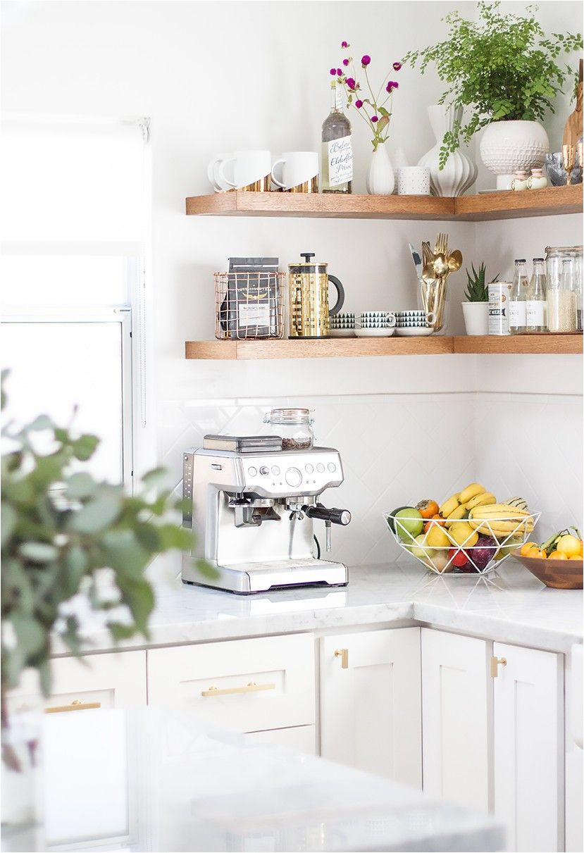 tour a wedding blogger s stunning renovated kitchen via mydomaine coffee corner kitchen corner shelves