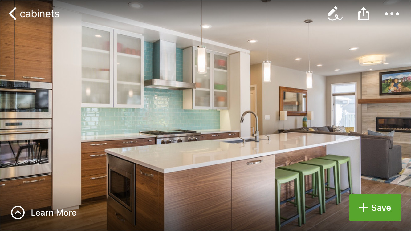 3 toned kitchen white upper cabinets with semi transparent doors glass tile backsplash in cool color tone warm wood medium walnut in base cabinets 2