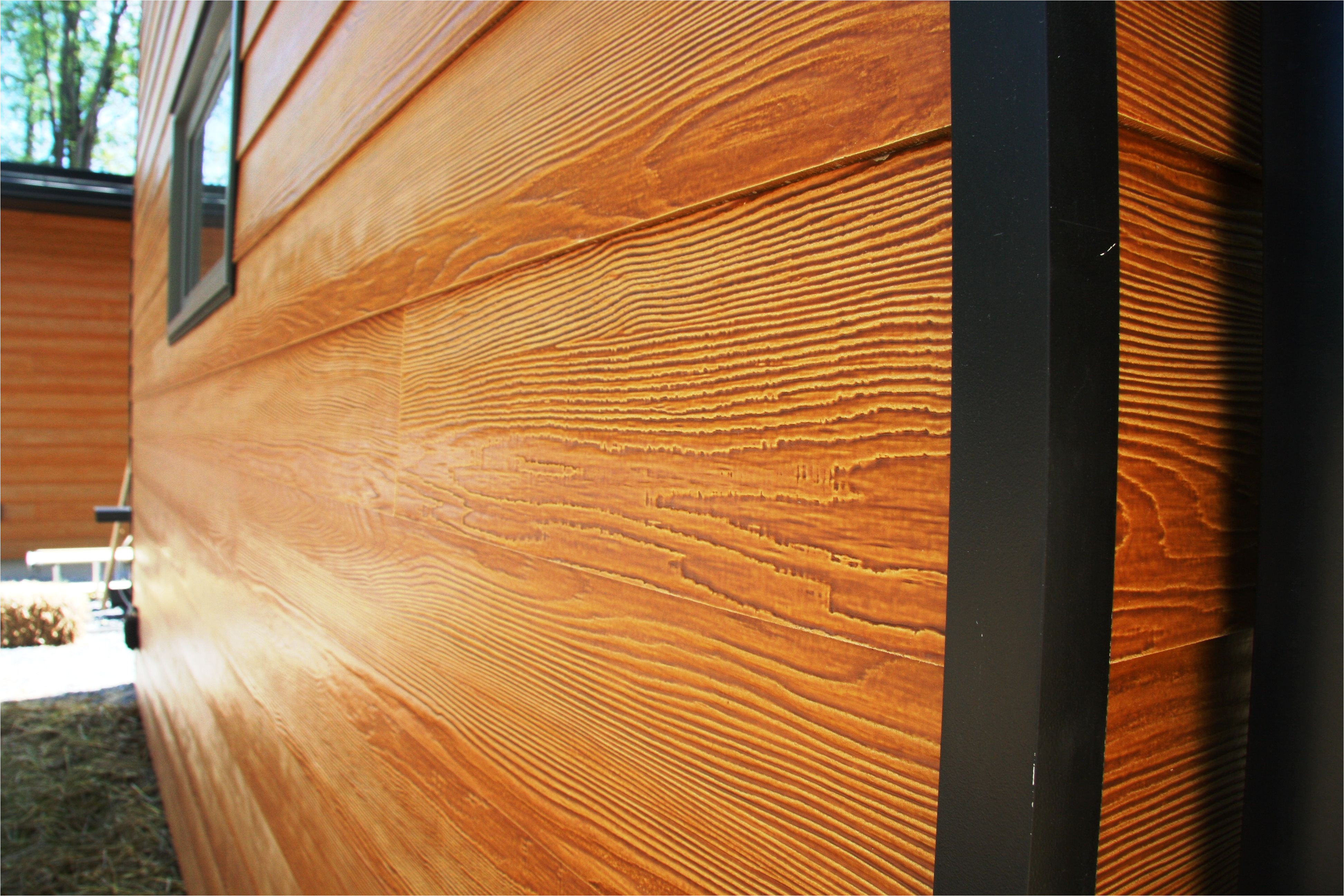 certainteed fiber cement siding closeup view cedar or maple stain source doesn t list finish