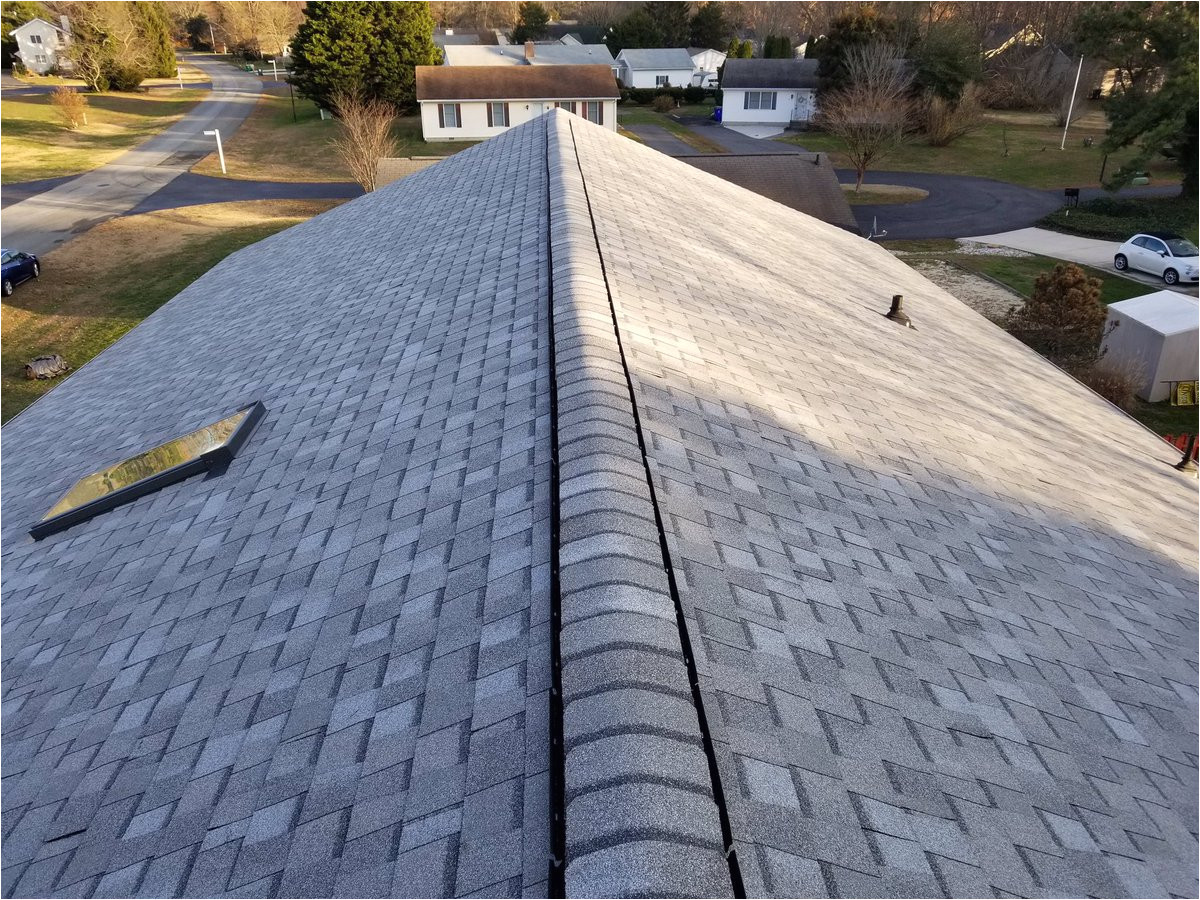 with a certainteed cobblestone gray landmark shingle this roof replacement required the removal of two layers of shingles and re flashing the chimney