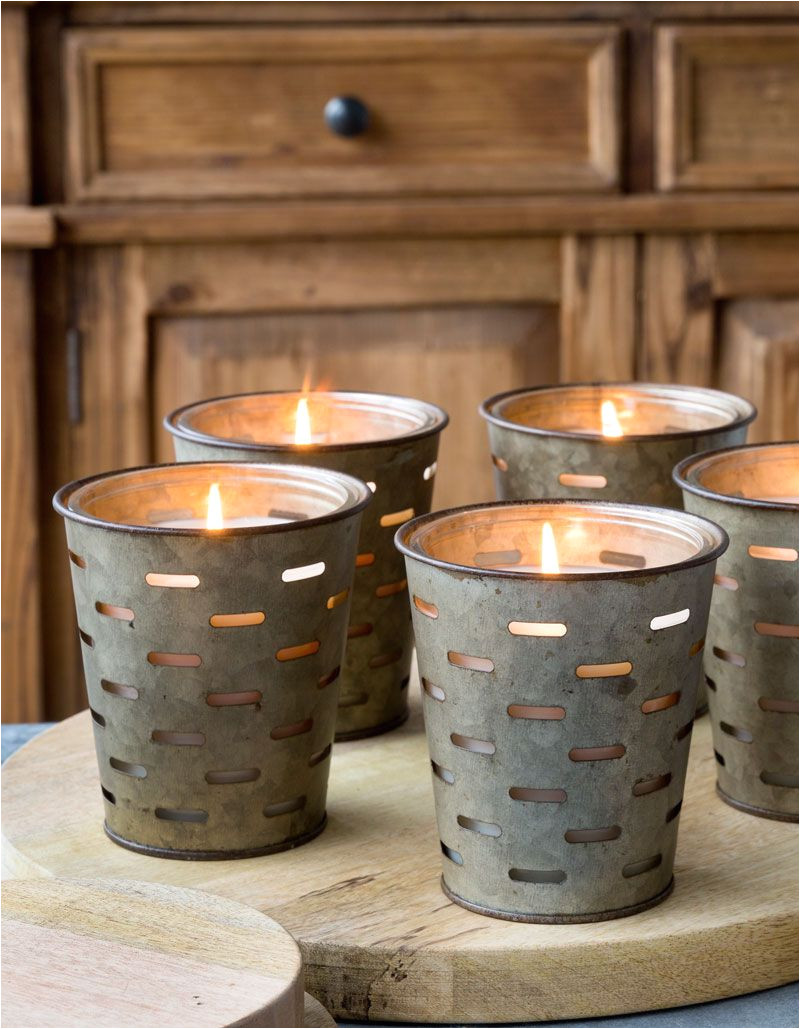metal olive bucket candles these have a glass sleeve so once the candle is burned down they can be reused with small pillar candles 25 each