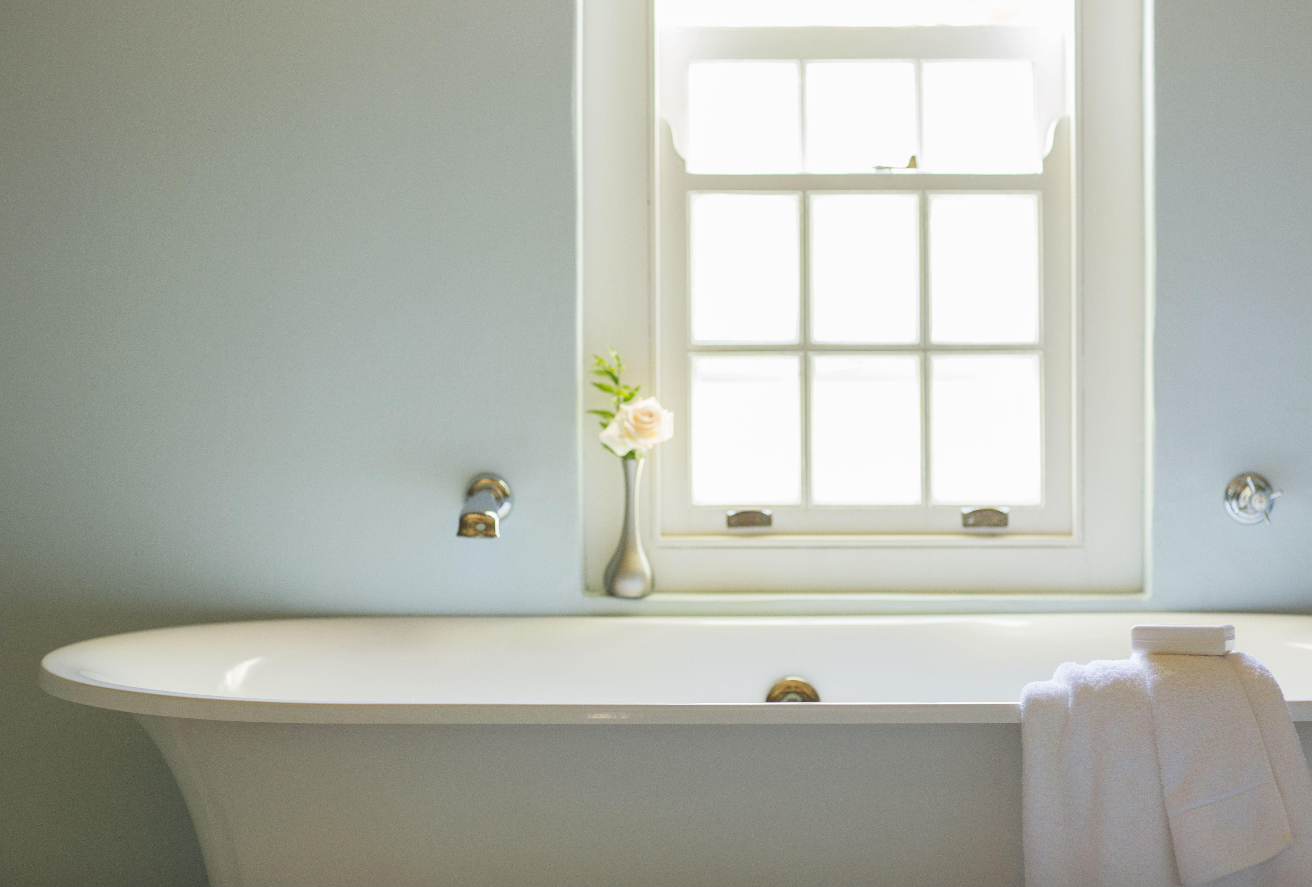 soaking tub below window in luxury bathroom 494358425 5aa1e931c064710037061882 jpg