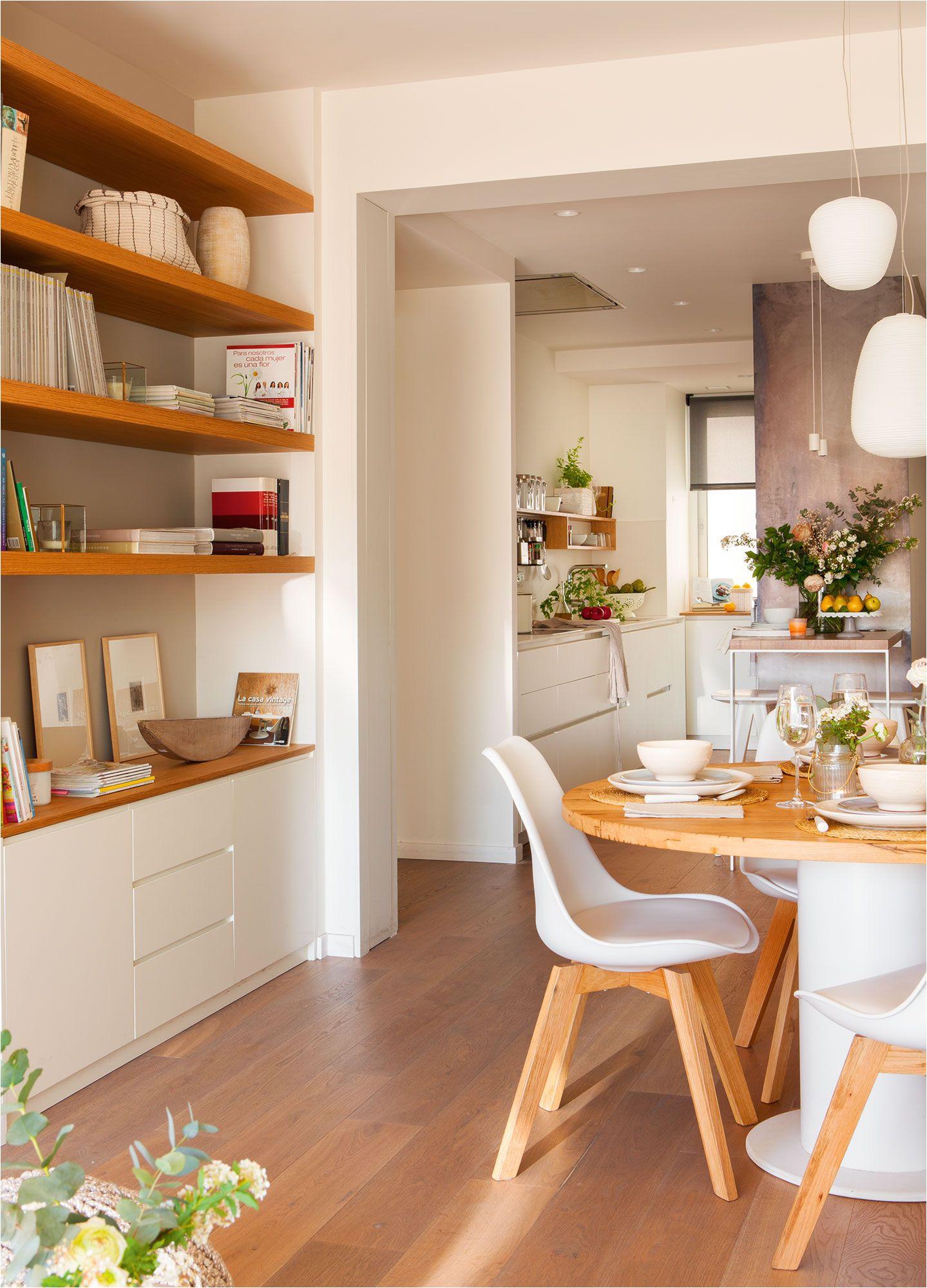 sala n con comedor mueble a medida con zona de librera a y mesa con sobre de roble reciclado de antiguas cubas de vino disea o de vivestudio