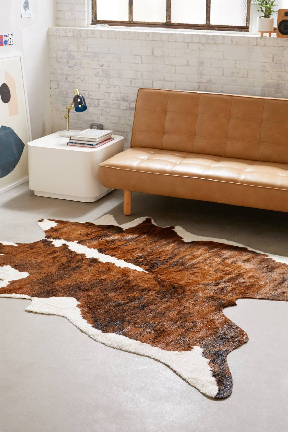 shaped faux animal hide rug urban outfitters