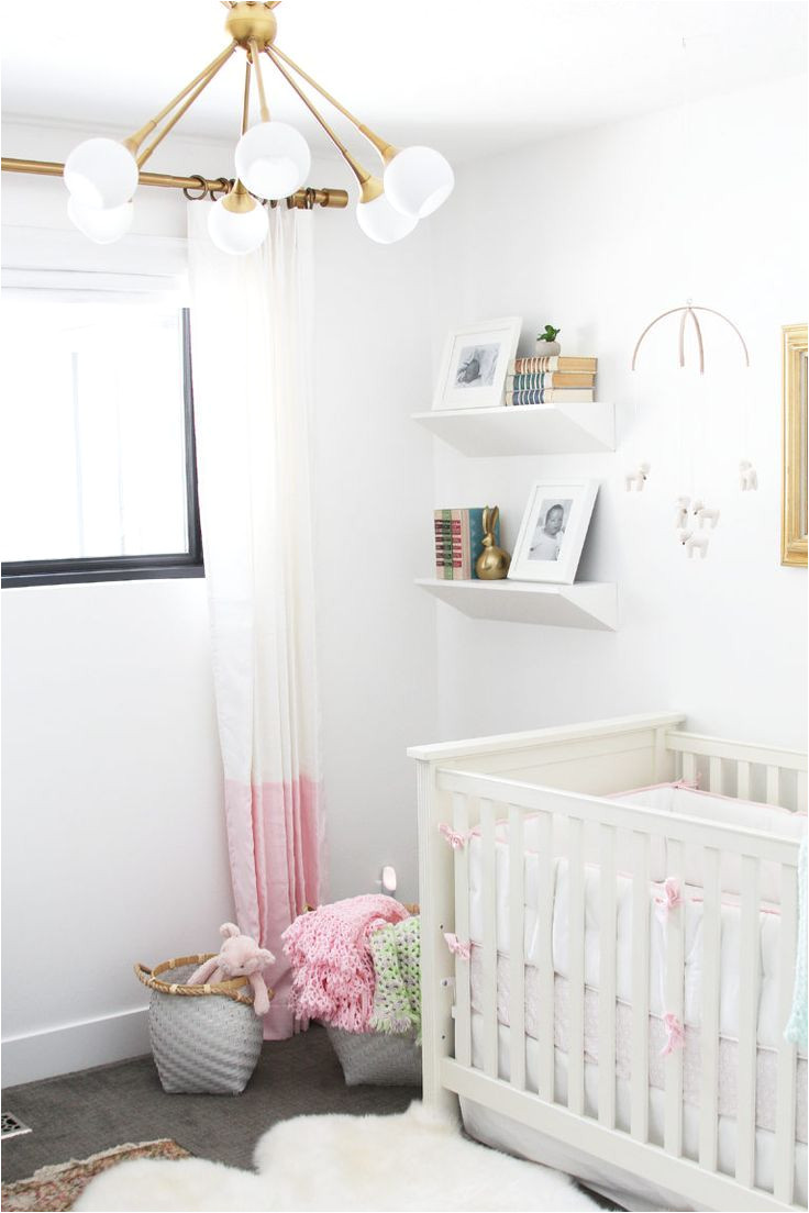 pink nursery with pops of metallics crib bedding by serena lily image via