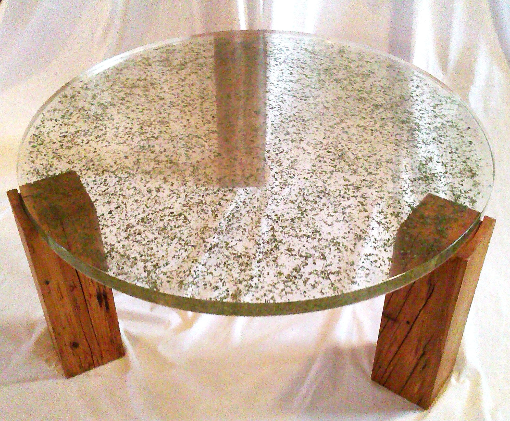translucent resin table top with embedded crushed leaves by fogliart
