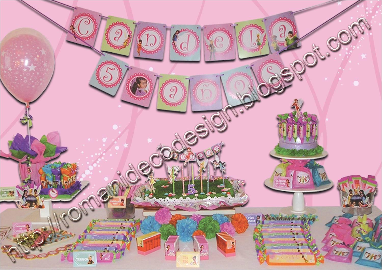 en la guirnalda en los souvenirs en los centro de mesa con globos y en la torta el resultado un cumple muy colorido en tonos bien femeninos