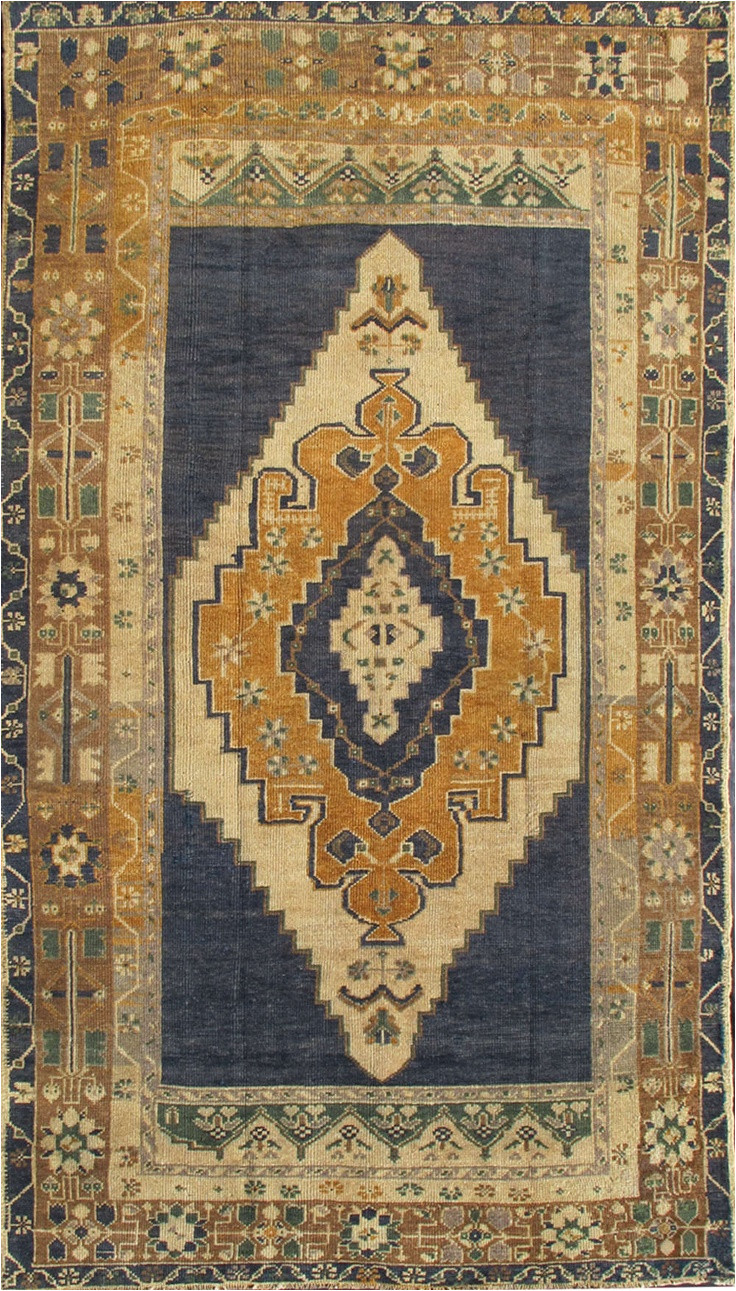 1940 gold and navy blue oushak wool rug from turkey handsome
