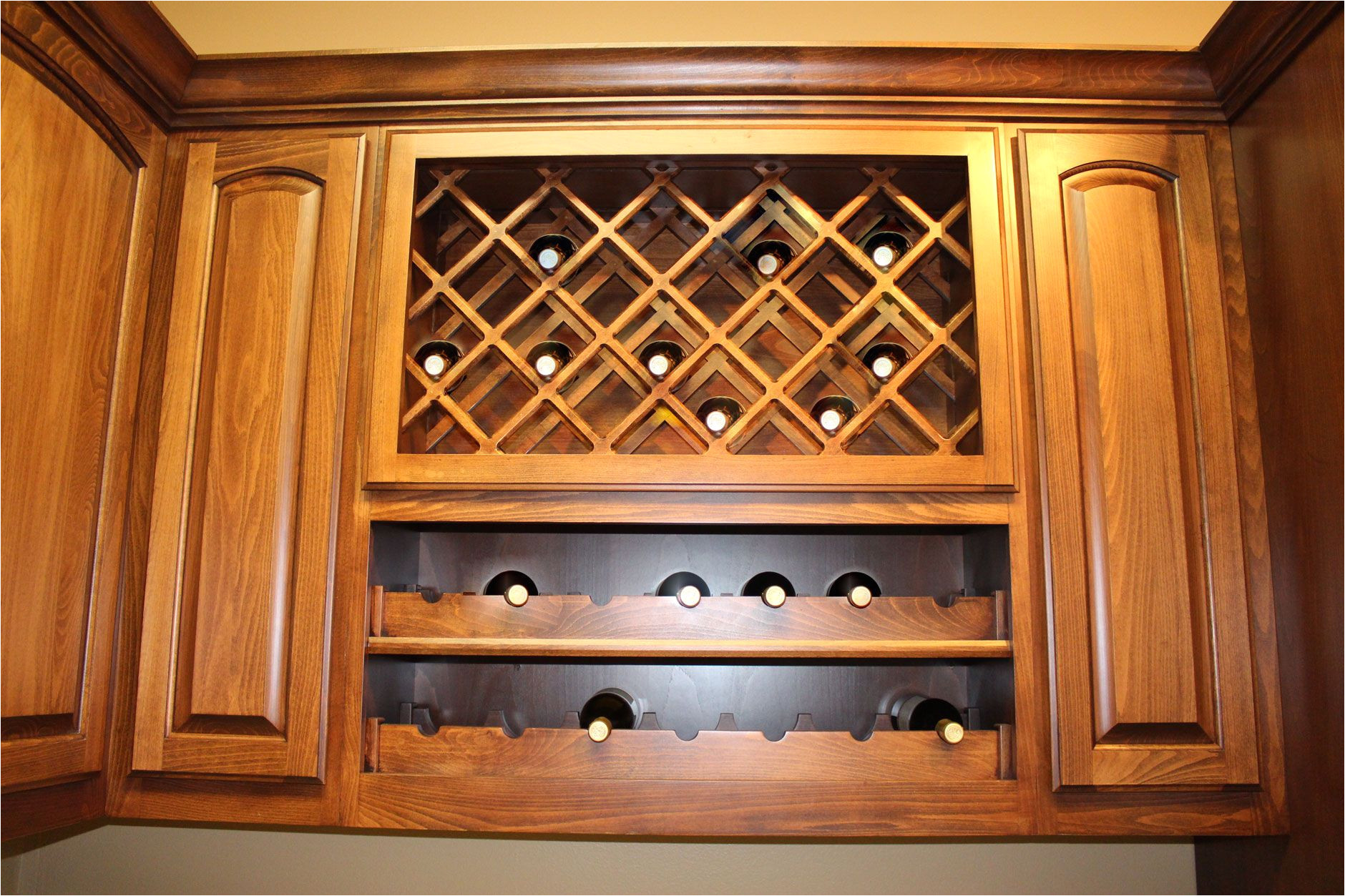 kitchen wine rack with lattice wine rack over scalloped wine rack by burrows cabinets burrowscabinets com