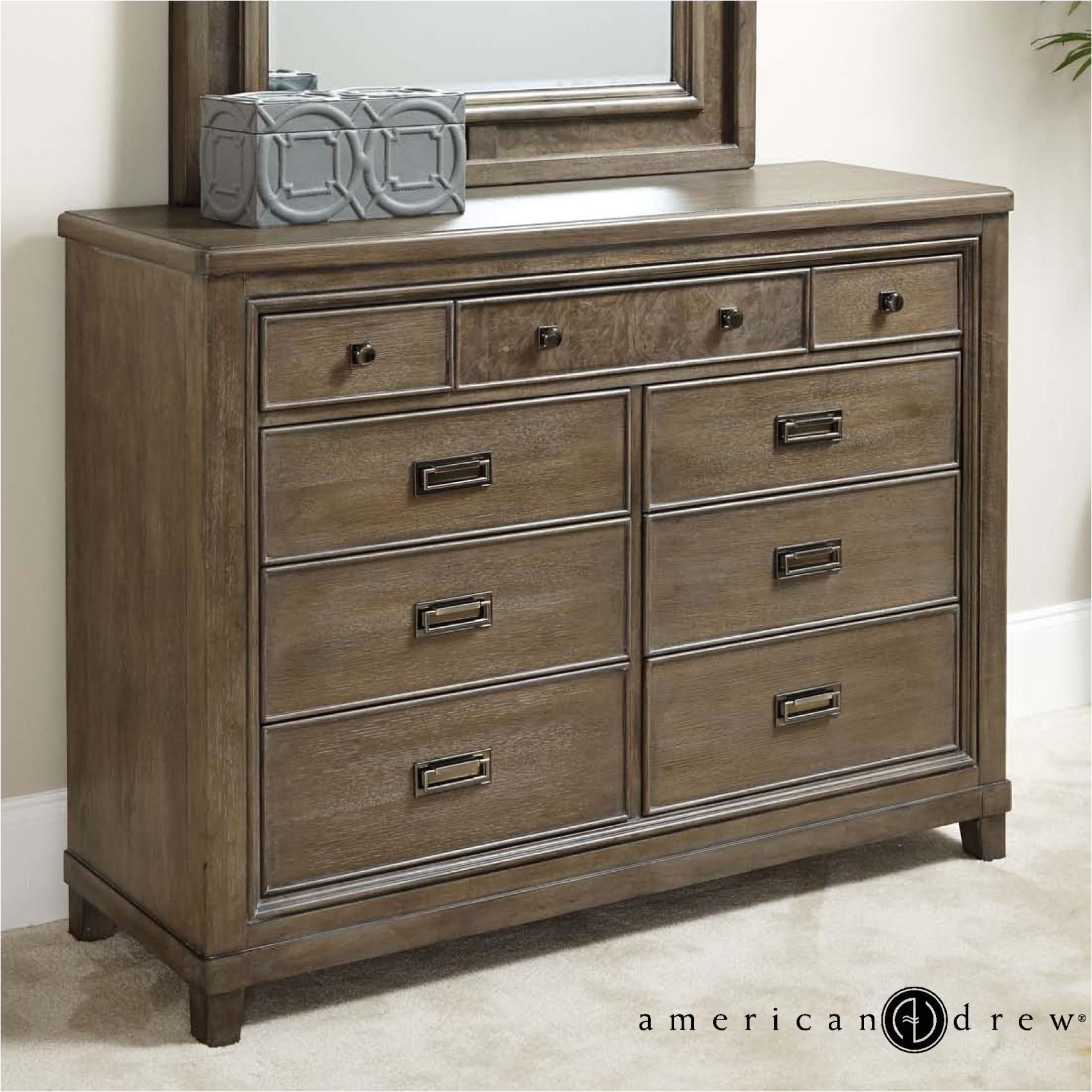 contemporary 9 drawer dresser with drop top center drawer with media storage