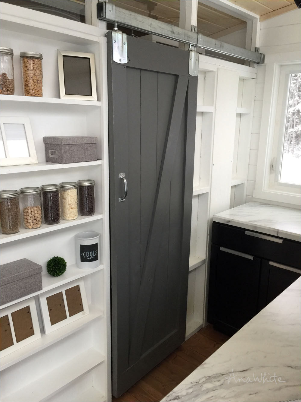how we built a barn door for our tiny house