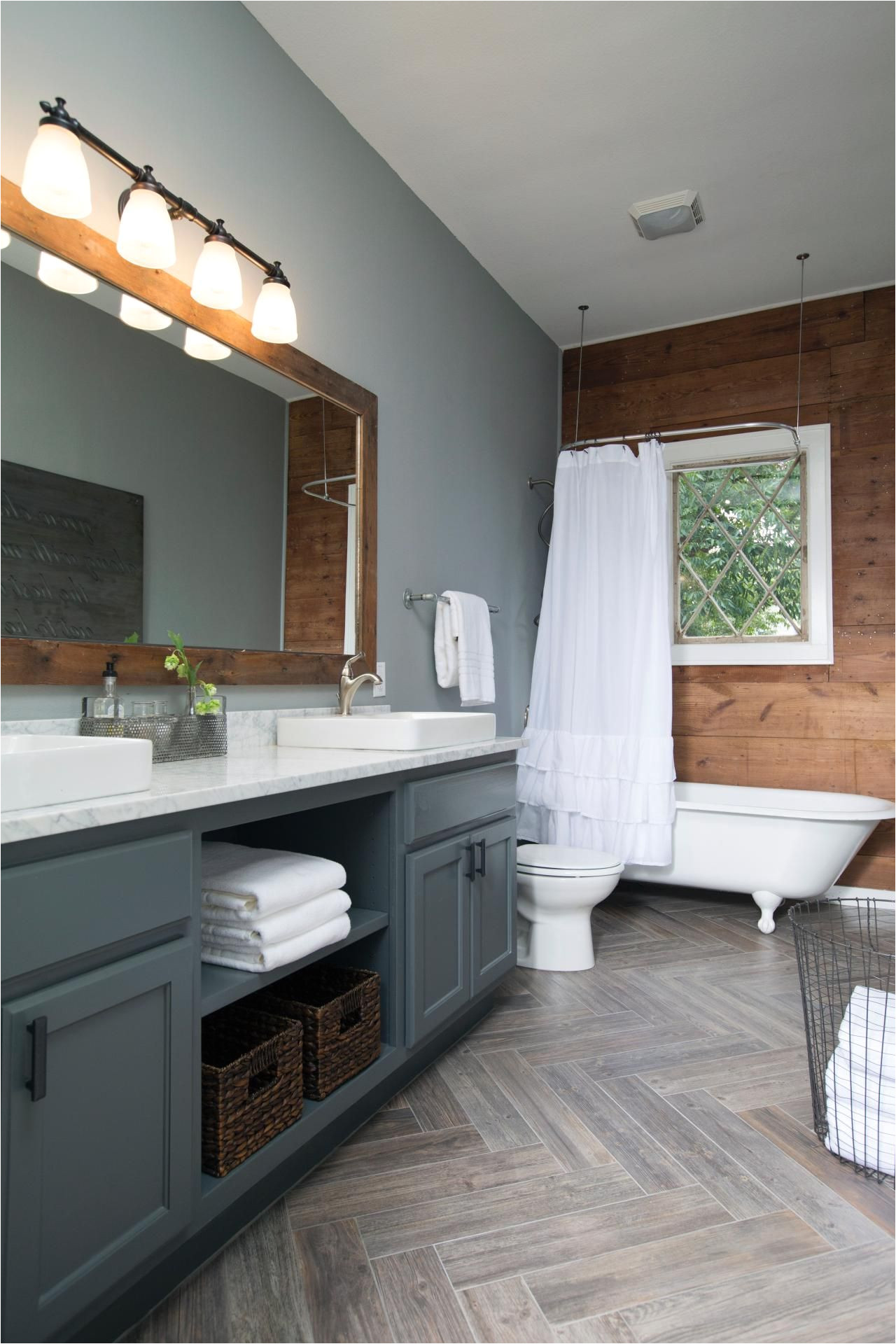 chip and joanna gaines decked out this master bathroom with new gray paint and a shiplap accent wall