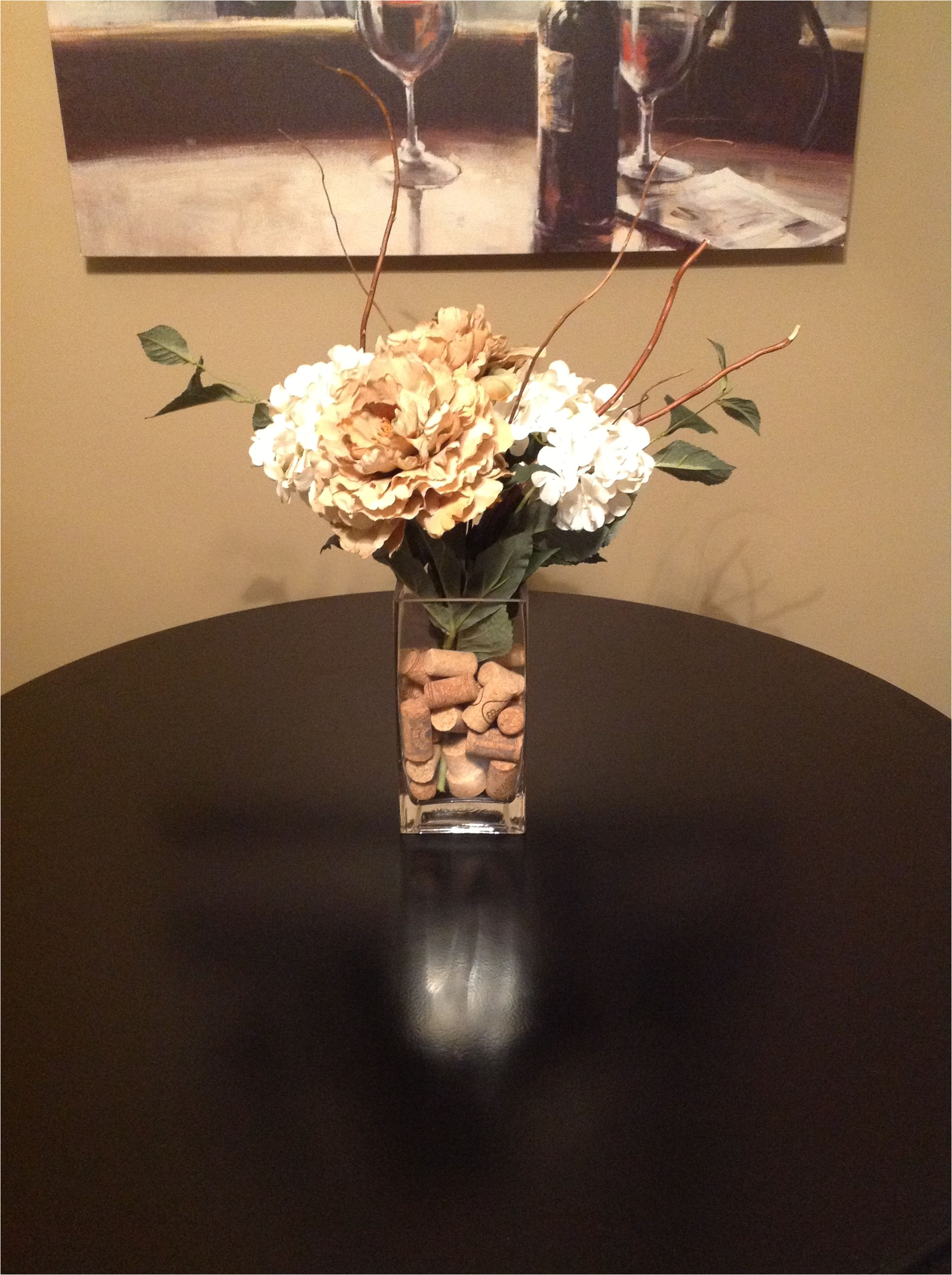 bought vase flowers and sticks from hobby lobby cut flowers to fit vase rubber band and bundle together at bottom and fill with wine corks from target